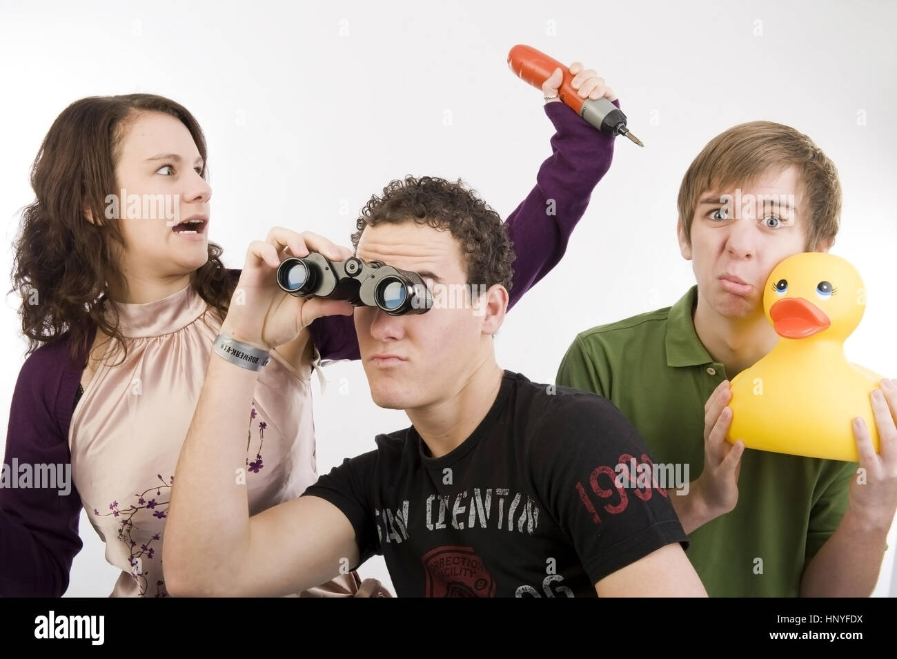Model release , Drei Jugendliche in lustiger Pose - three funny teenager - Stock Image