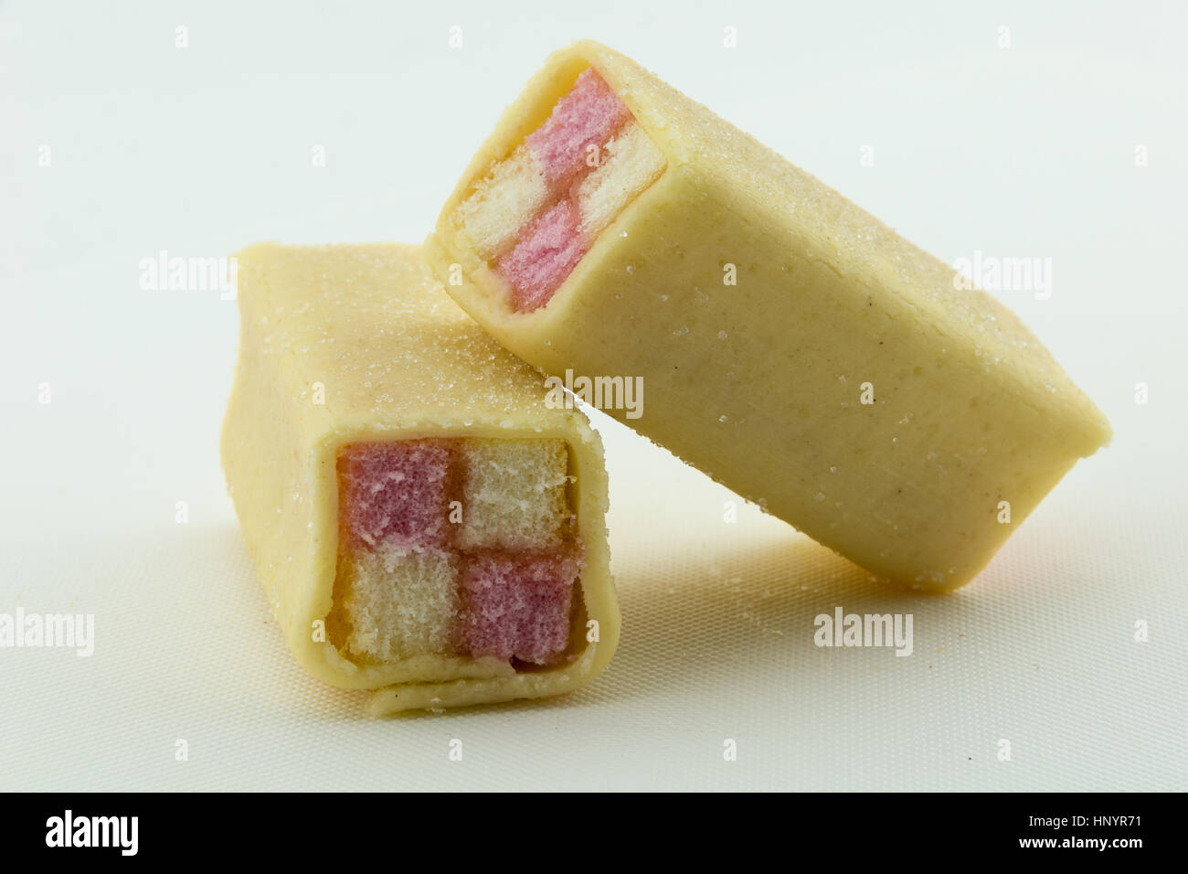 Two Battenberg cake on a white background - Stock Image