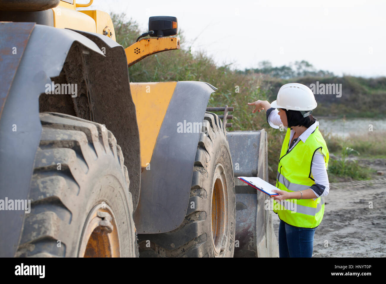 Woman engineer on a construction site, Selective focus and small depth of field - Stock Image