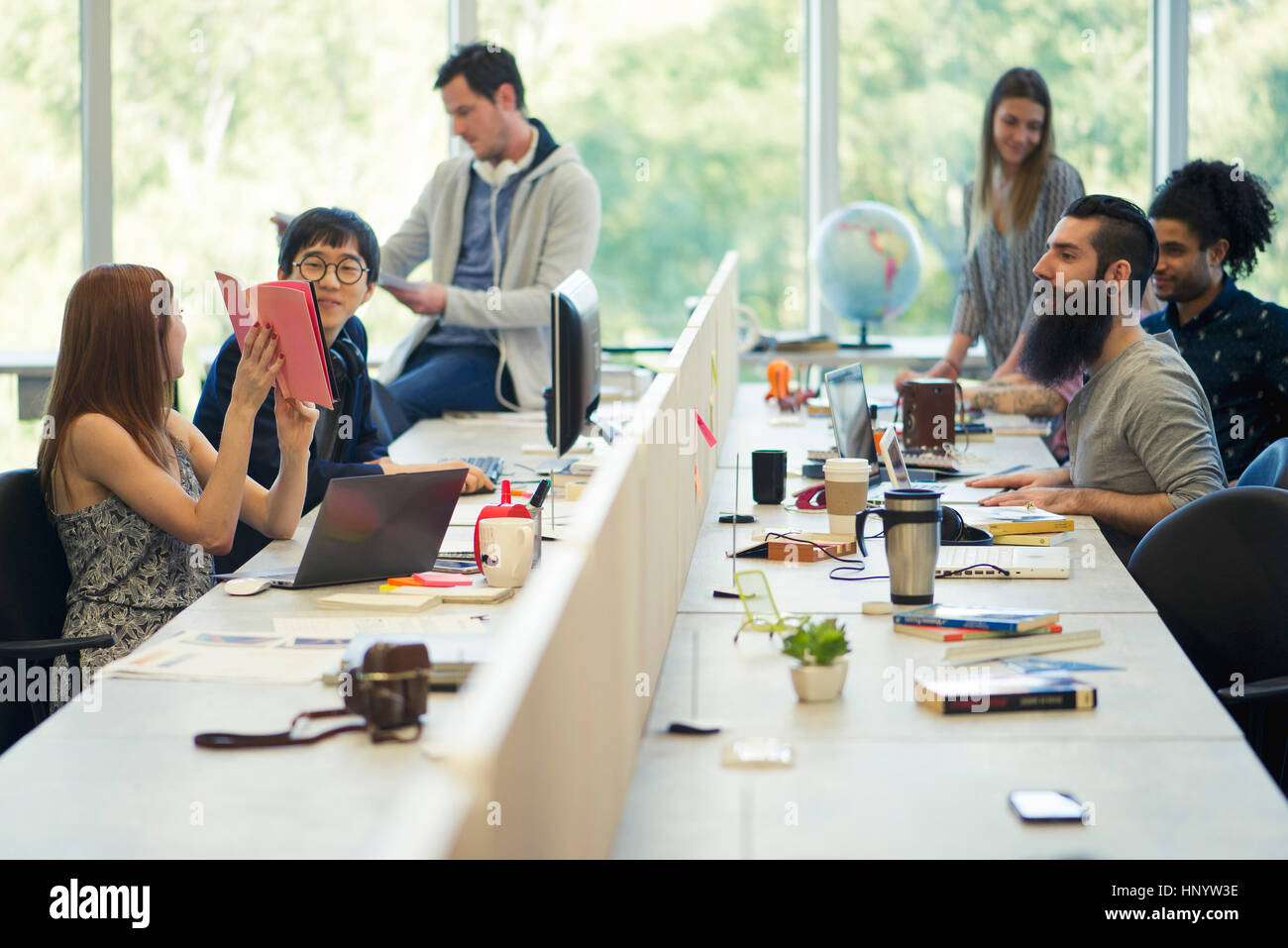 Entrepreneurs working in open plan office Stock Photo