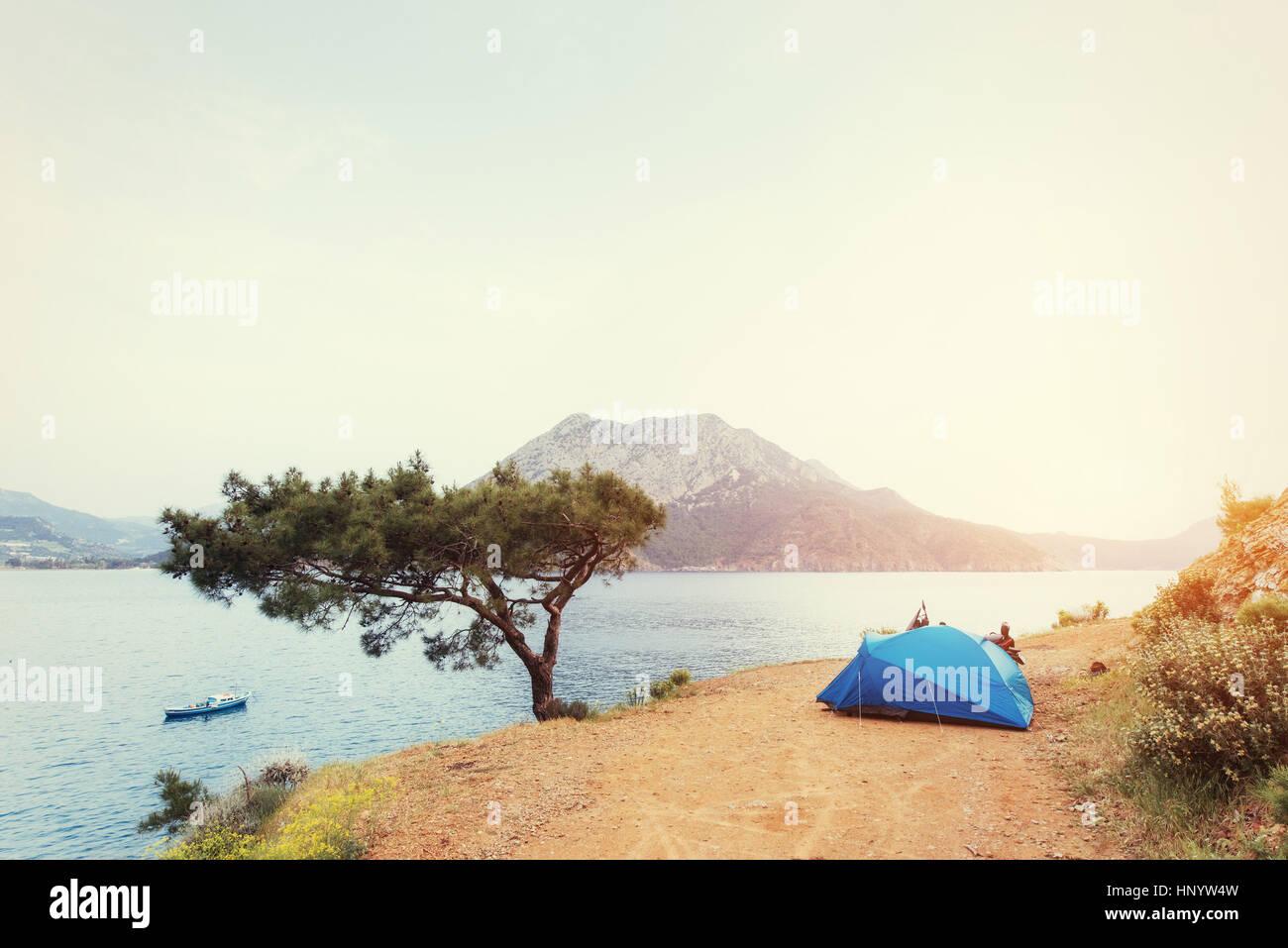 Blue tent on sandy wild beach at sunset light. Turkey - Stock Image