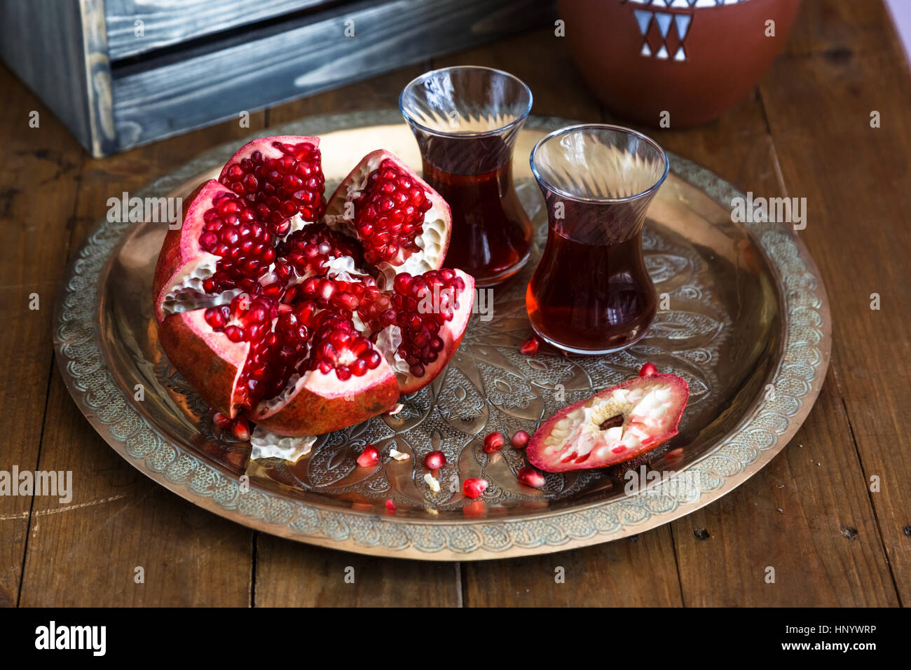 Ripe pomegranate fruit on wooden vintage table. Close view - Stock Image