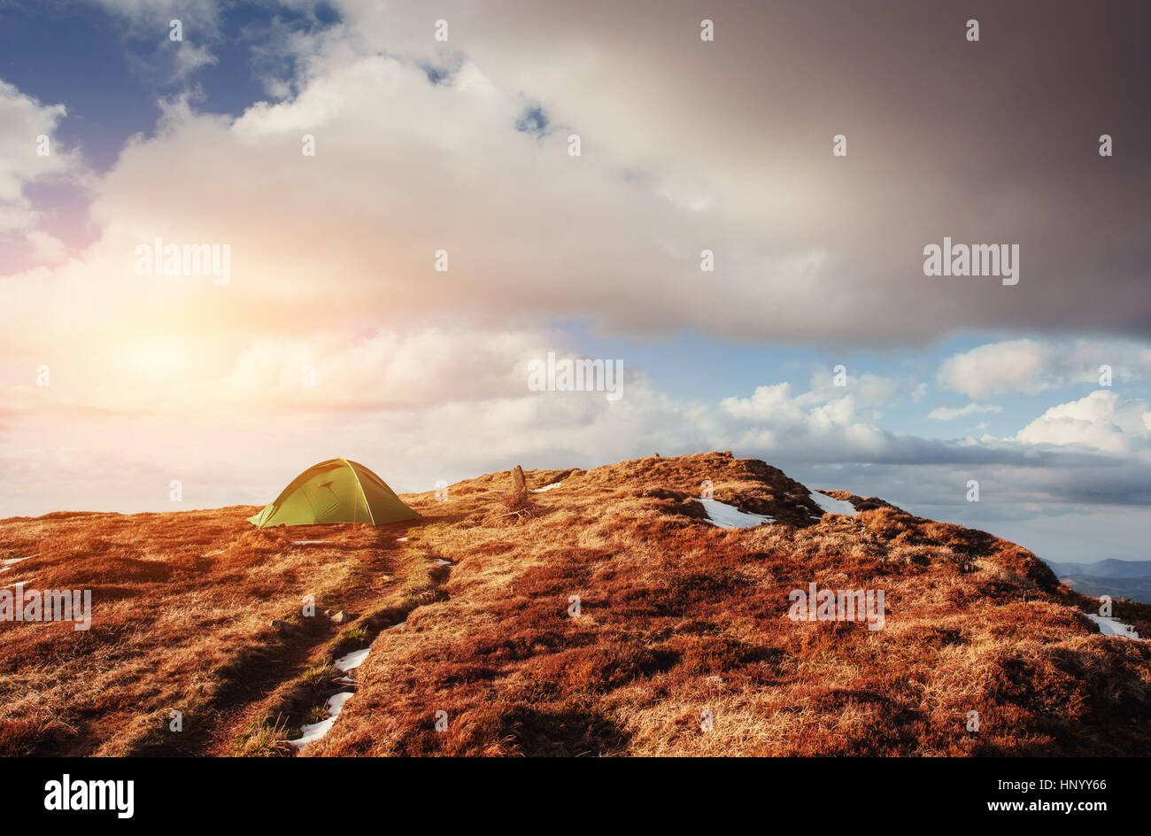 Tourist tent in the mountains in spring. - Stock Image
