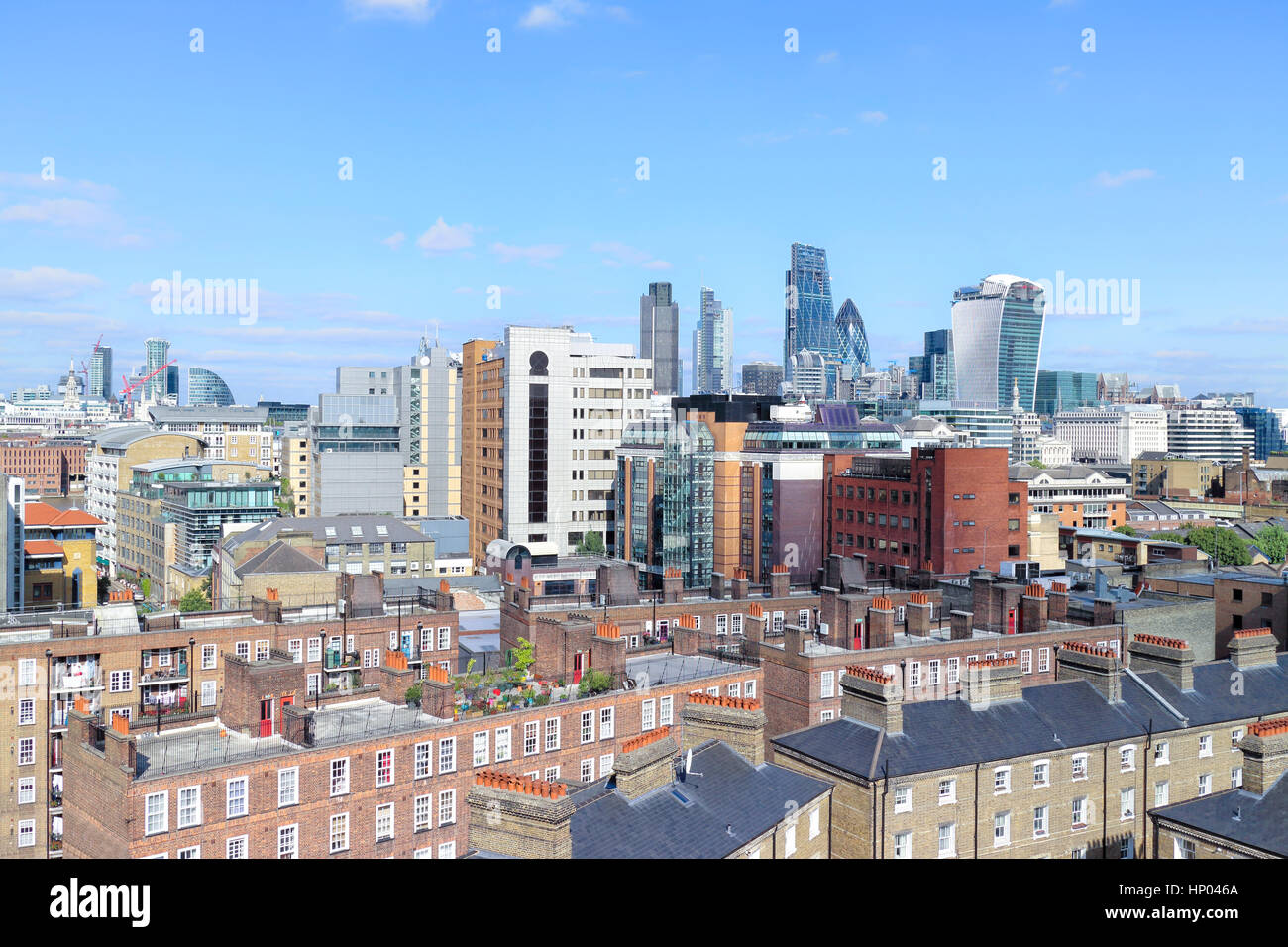 City of London skyline, over the roofs of houses in south bank, showing skyscrapers in a square mile in the distance - Stock Image