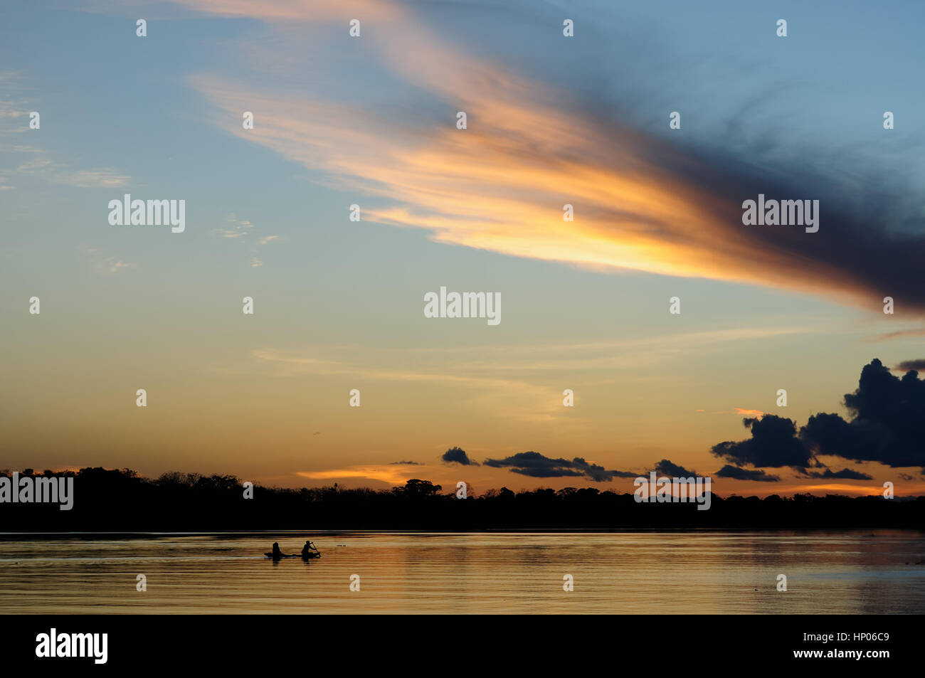 Amazon Native Americans Stock Photos Op Amp Amazonde In The Traditional Boat On Rays Of Setting Sun