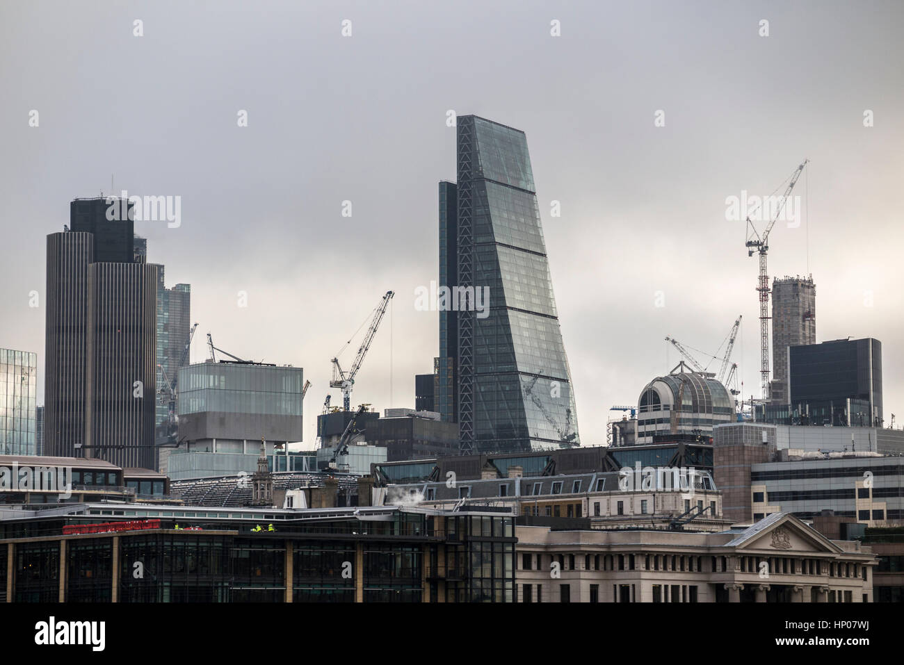 Tower cranes on the skyline of construction sites in the City of London with iconic modern architecture skyscrapers Stock Photo