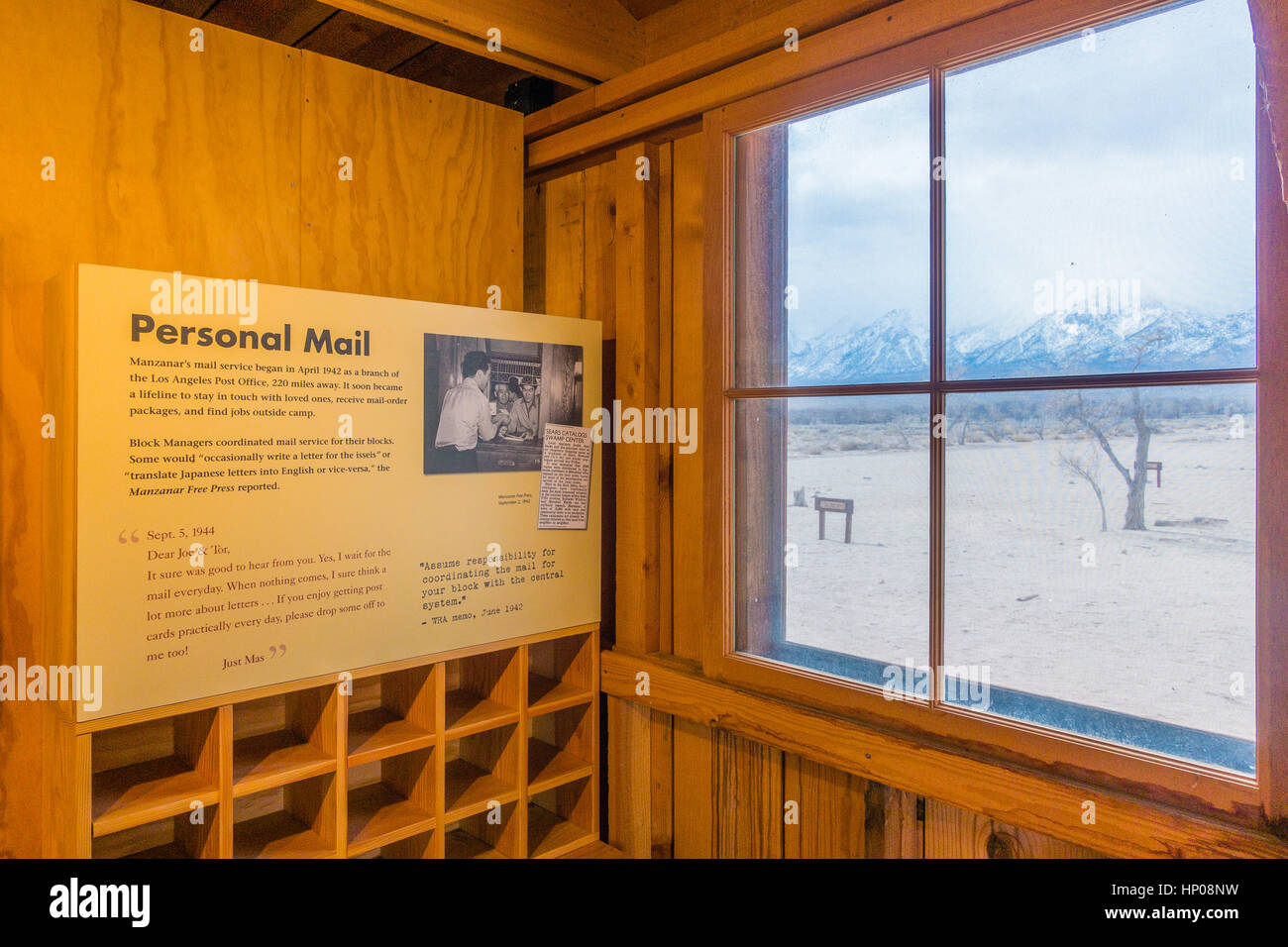 Manzanar, The World War II Japanese Internment Camp Housing, Inside Looking  Out Through A Window. With A Lighted Display Inside