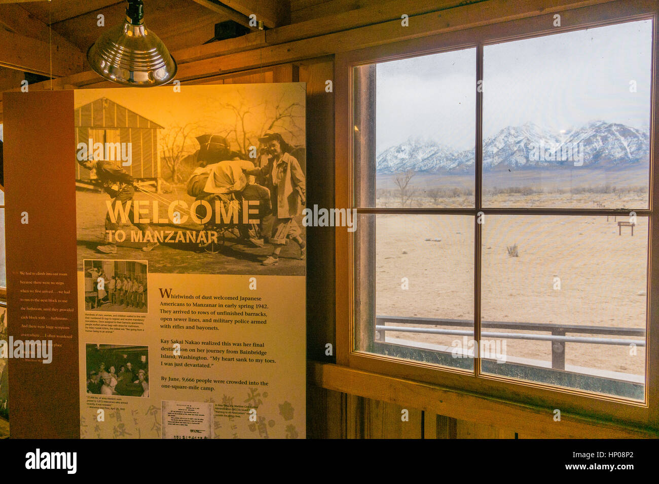 Manzanar, the World War II Japanese internment camp housing,  inside looking out through a window. with a lighted - Stock Image