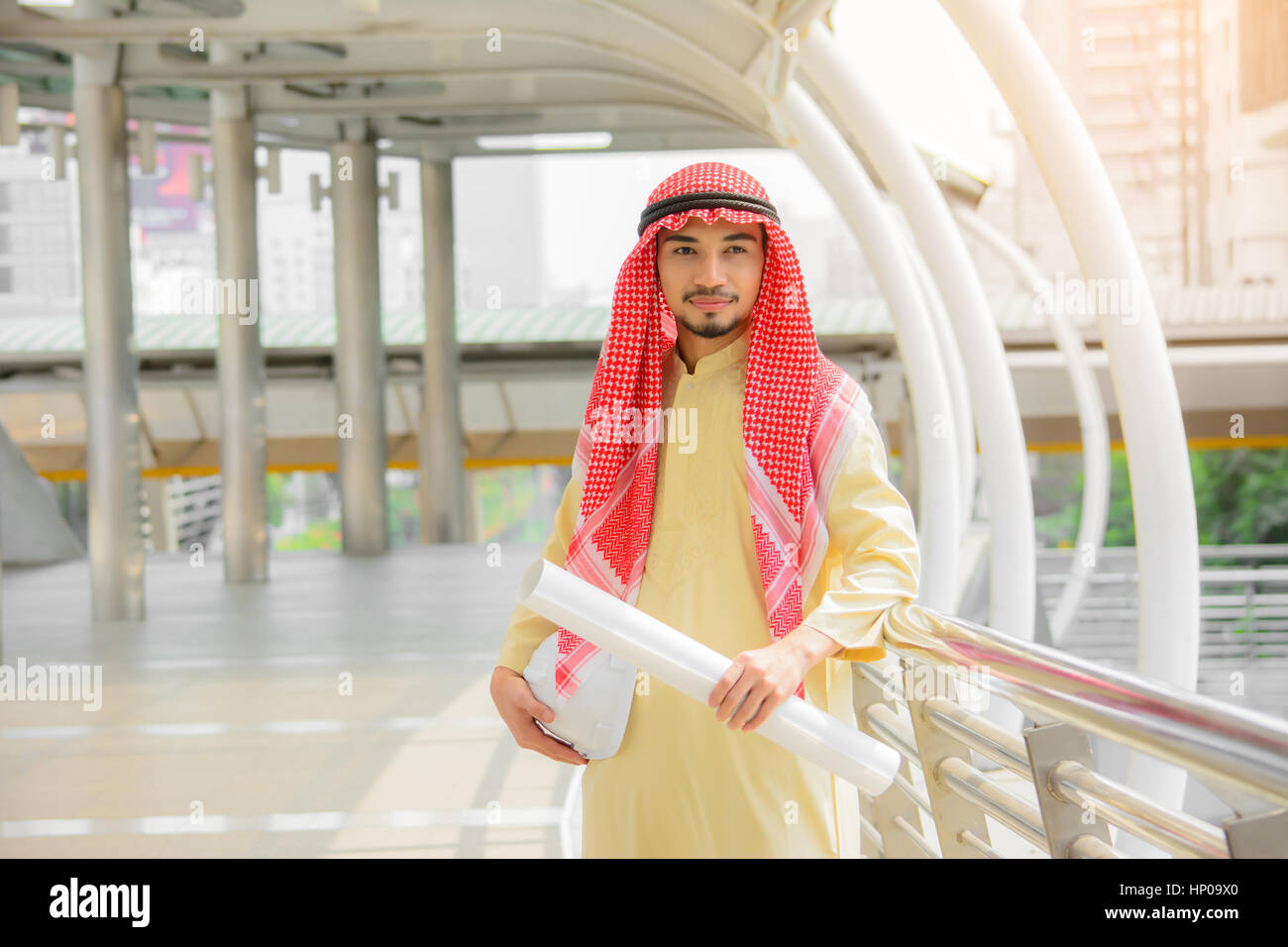 Happy handsome arab businessman standing outdoor with  city background.Business concept. - Stock Image