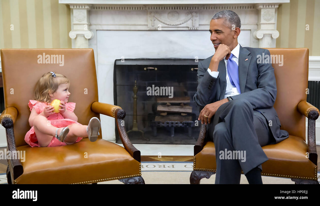 PRESIDENT BARACK OBAMA with David Axelrod's granddaughter Maelin in the VP's chair on 22 June 2016.  Photo: - Stock Image