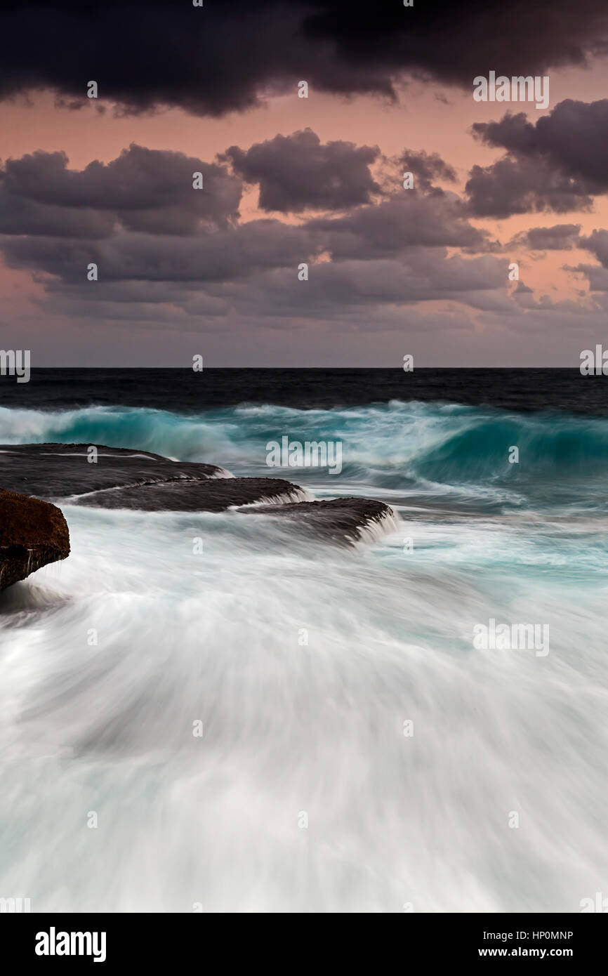 Sydney northern beaches seascape near freshwater beach. Pacific ocean coast at sunrise with strong surfing waves - Stock Image