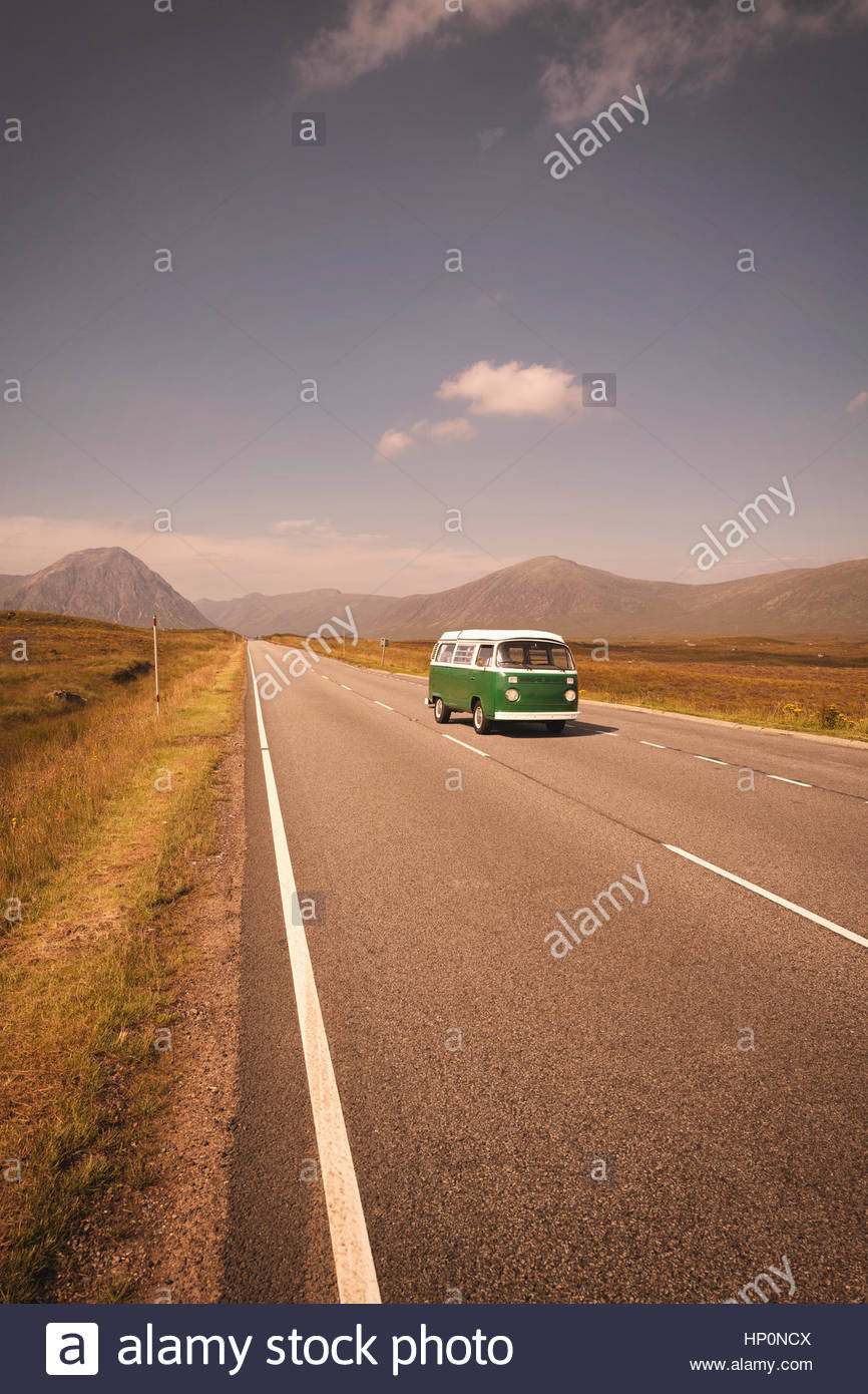 Vintage VW Volkswagen bus green road trip highway - Stock Image