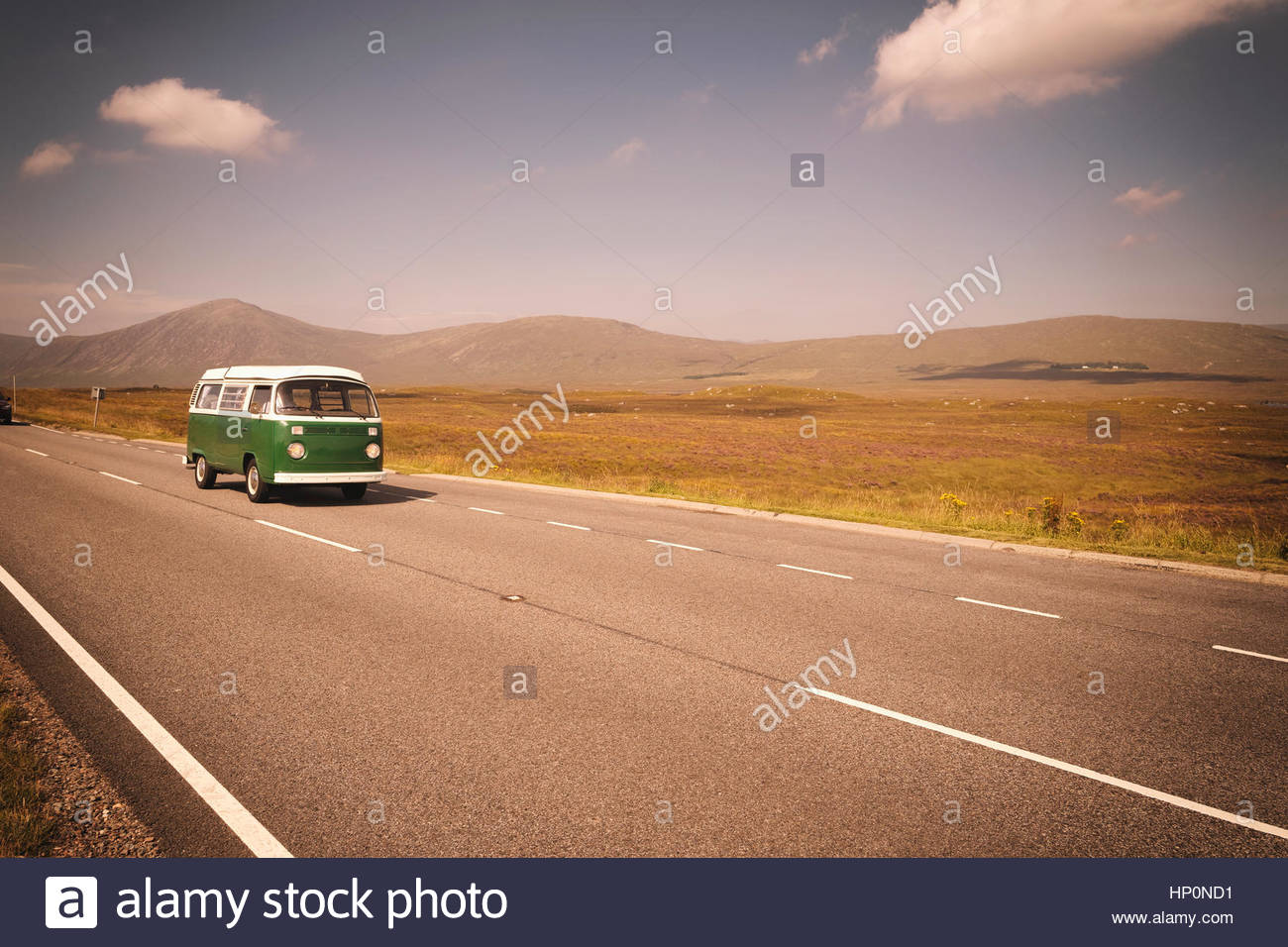 Vintage VW Volkswagen bus green road trip highway - Stock Image