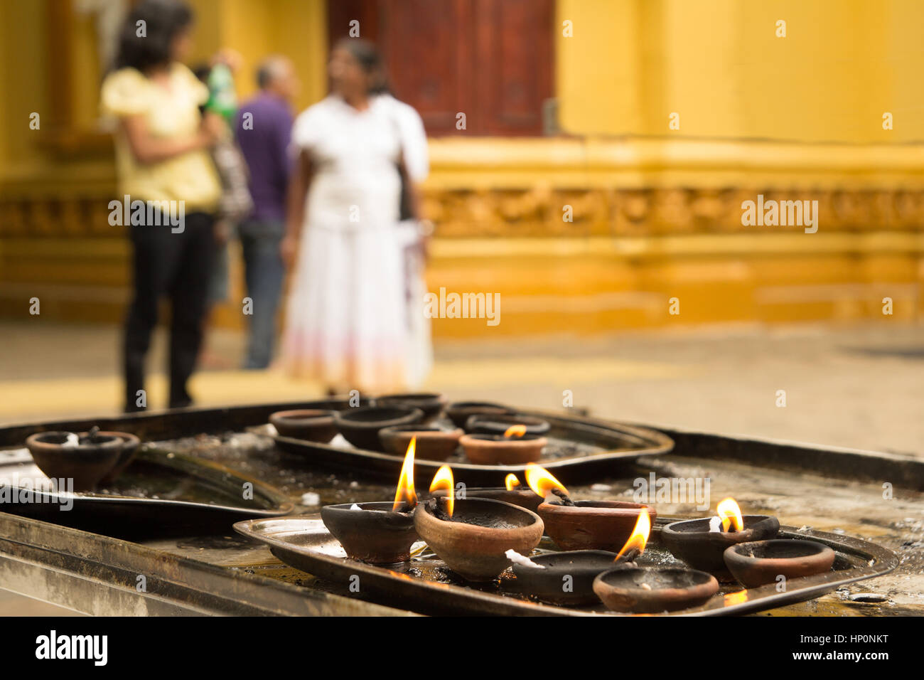 clay oil lamps in hinduist temple - Stock Image