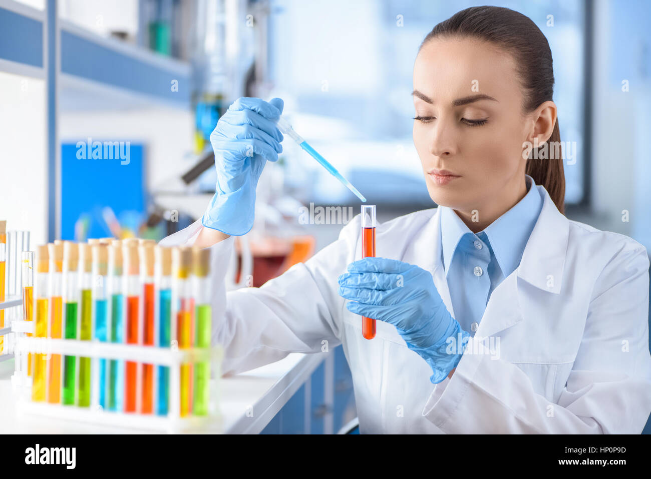 scientist working with laboratory tube - Stock Image