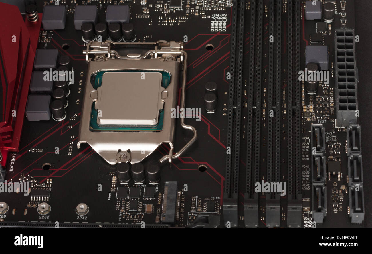 Close up of installed CPU processor on modern, new, gaming motherboard. - Stock Image