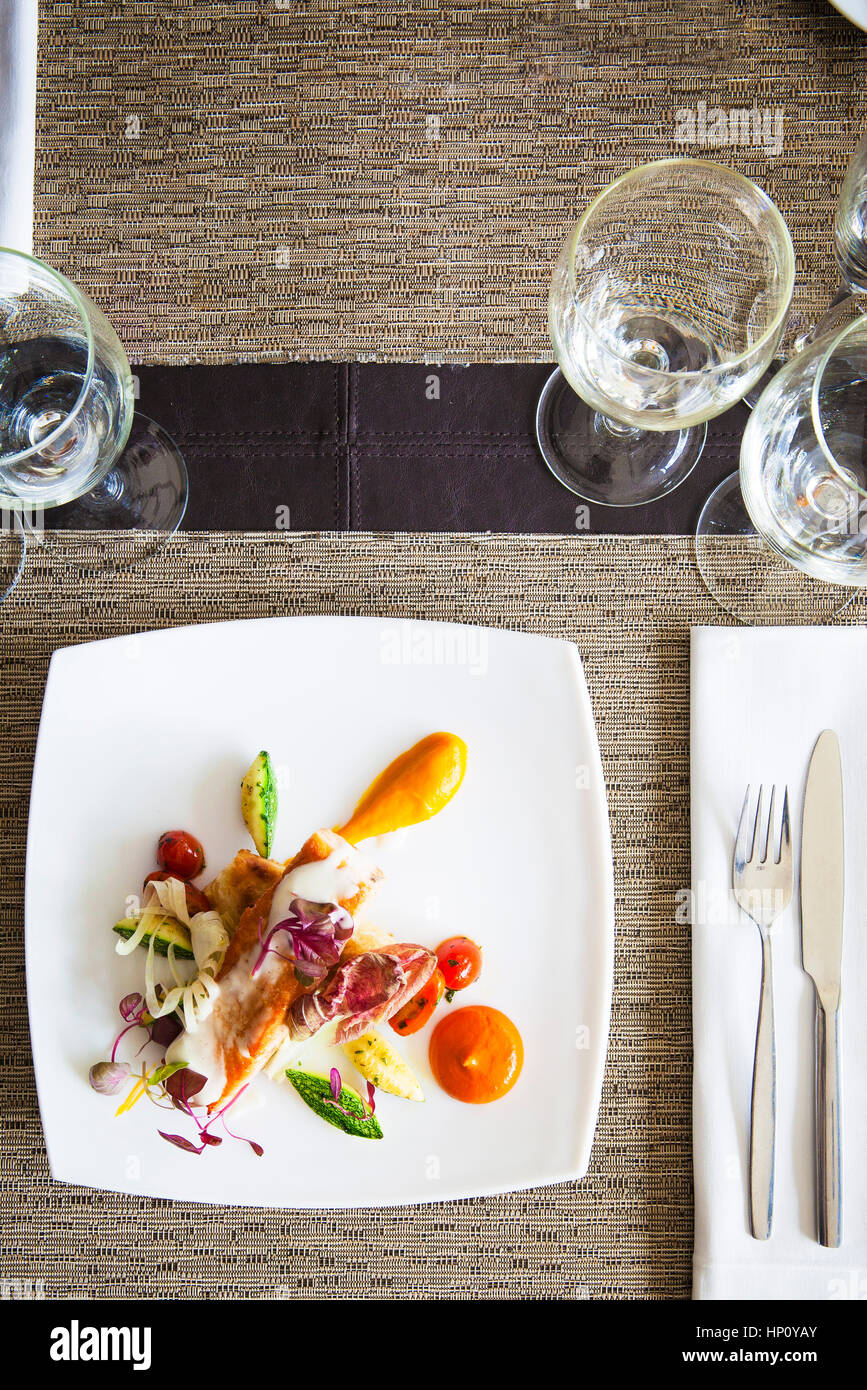 Salmon and vegetable dish served in restaurant - Stock Image