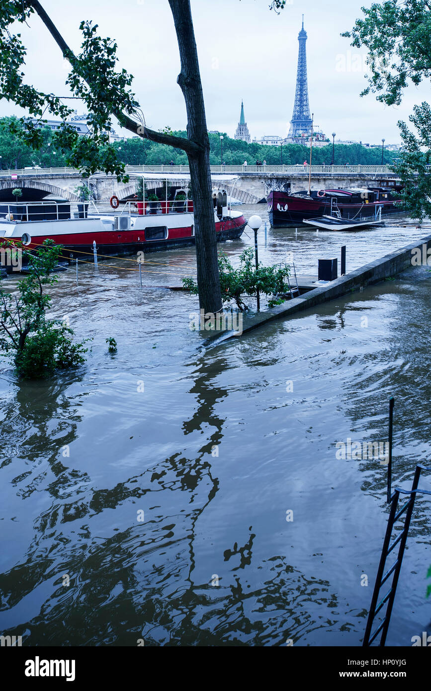 Flooded bank of the Seine River in Paris, France - Stock Image