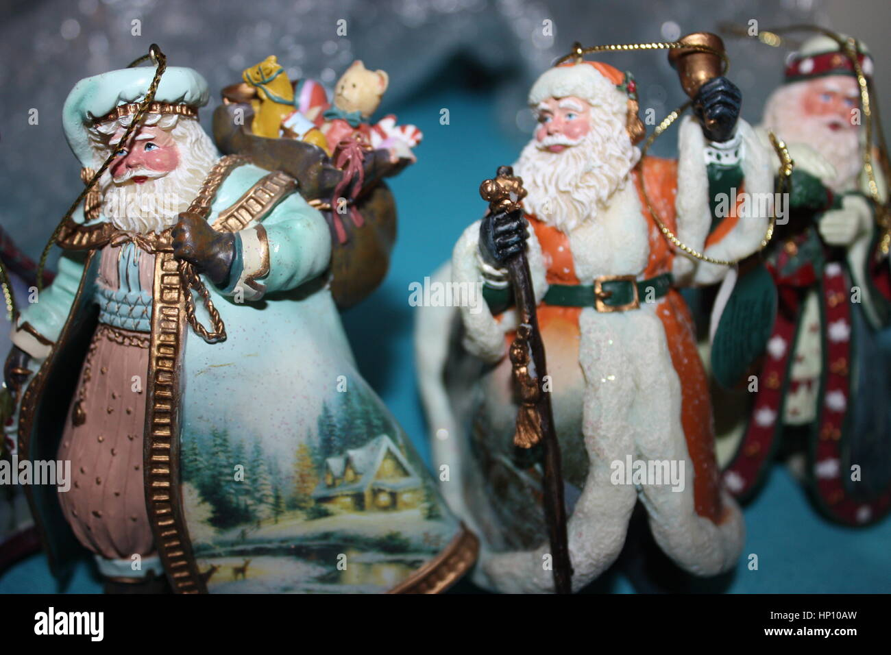 This Is A Close Up Picture Of 3 Thomas Kinkade Christmas Ornaments