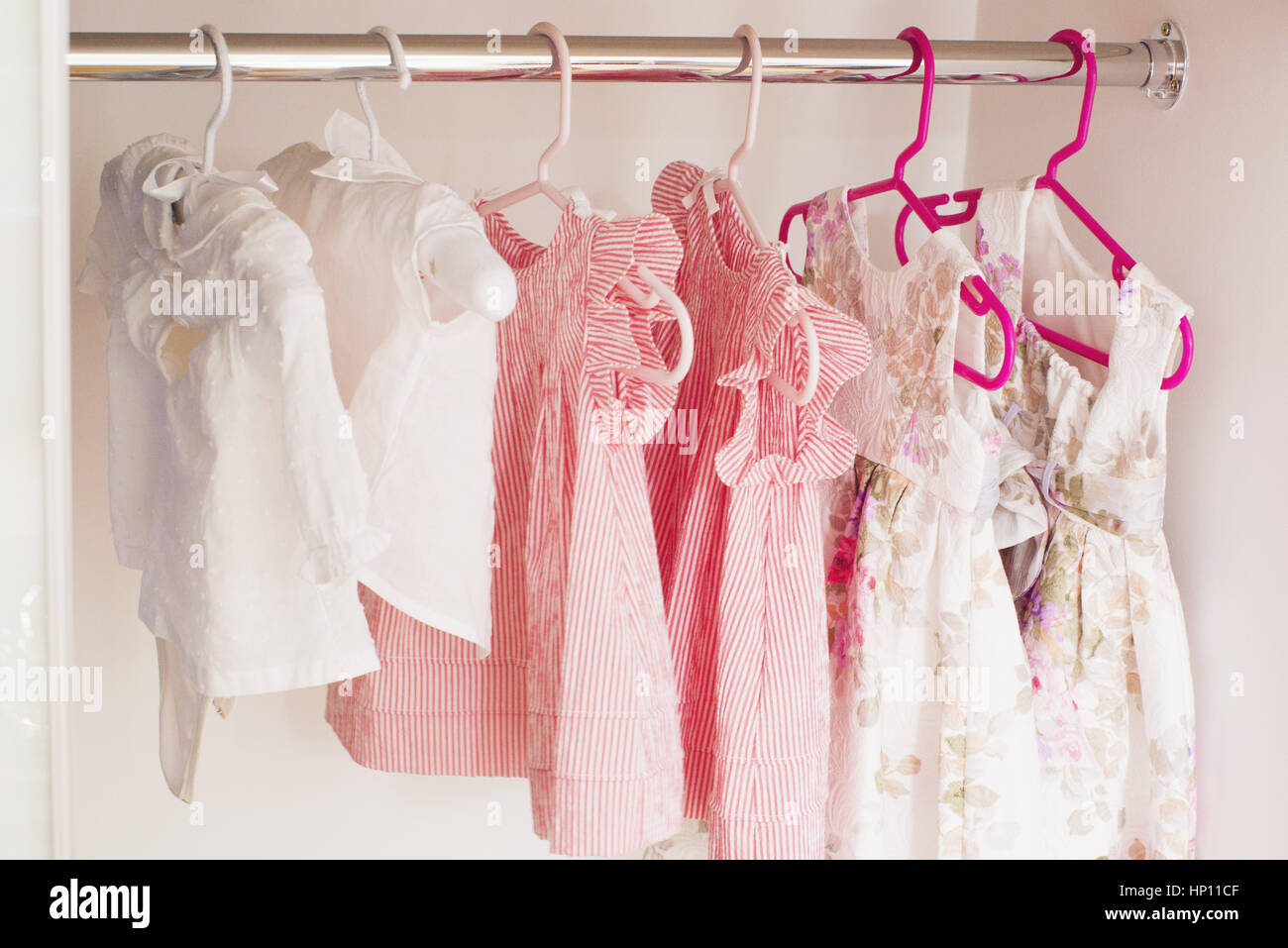 baby clothes hanging in closet stock photo 134018095 alamy