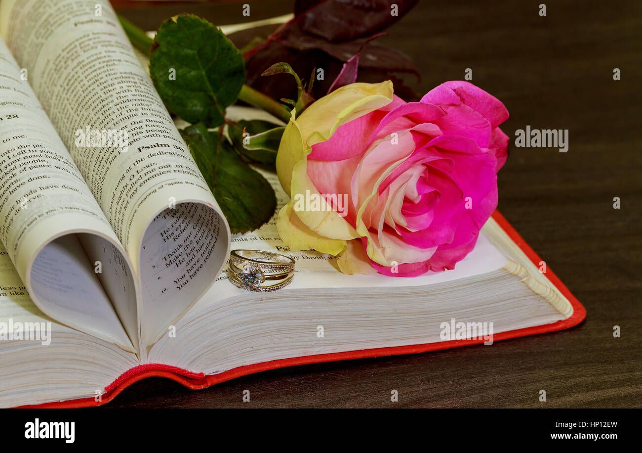 wedding ring on the bible - Stock Image
