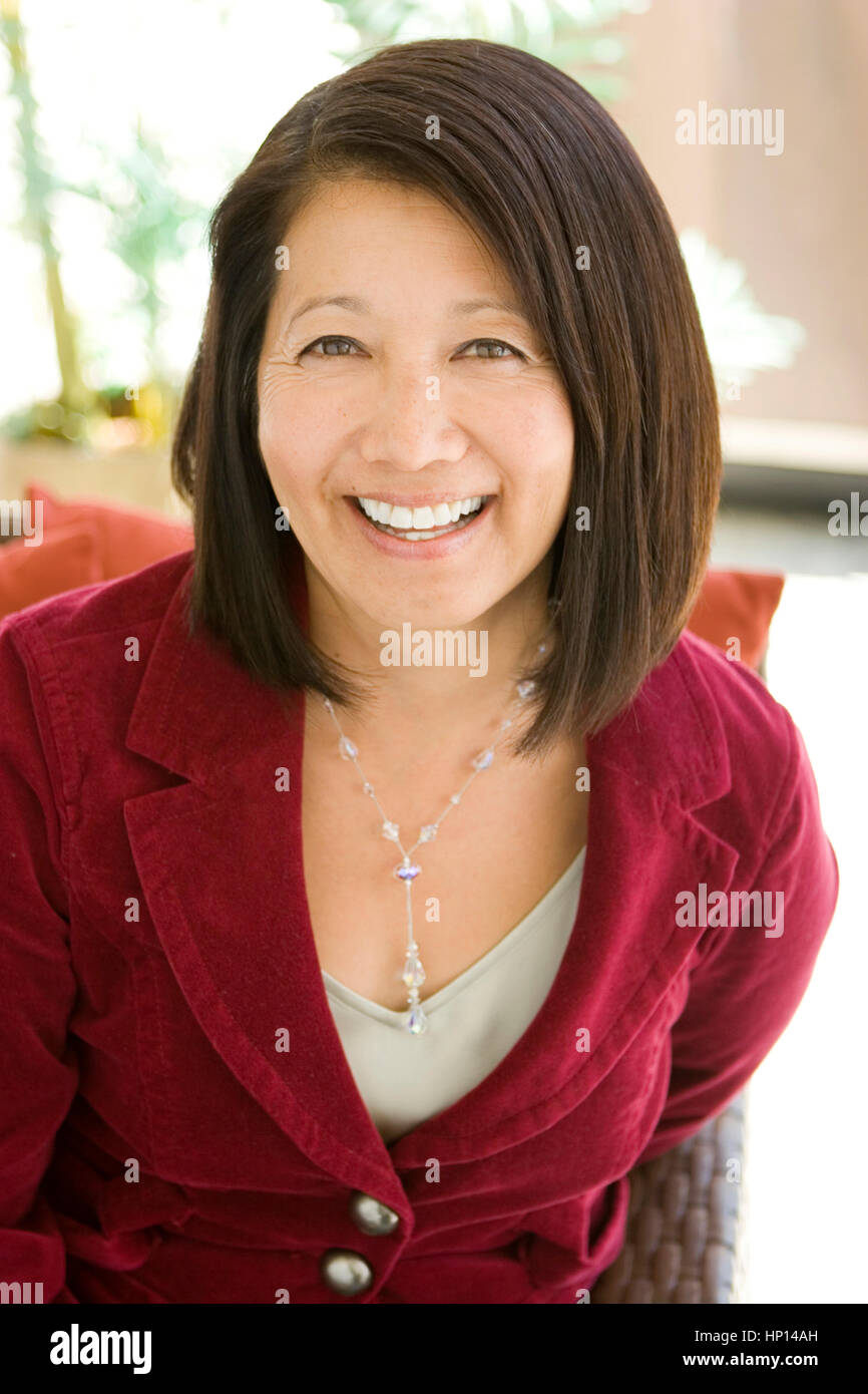 beautiful mature confident asian woman smiling stock photo