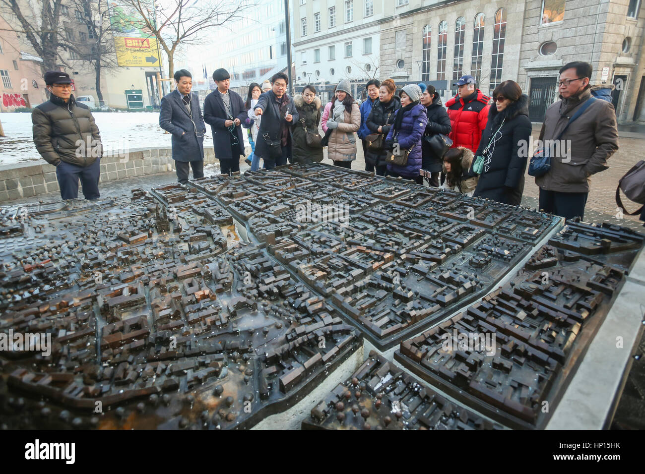 ZAGREB, CROATIA - JANUARY 15, 2017 : Tourists sightseeing the scale model of Zagreb city exhibited at the European Stock Photo