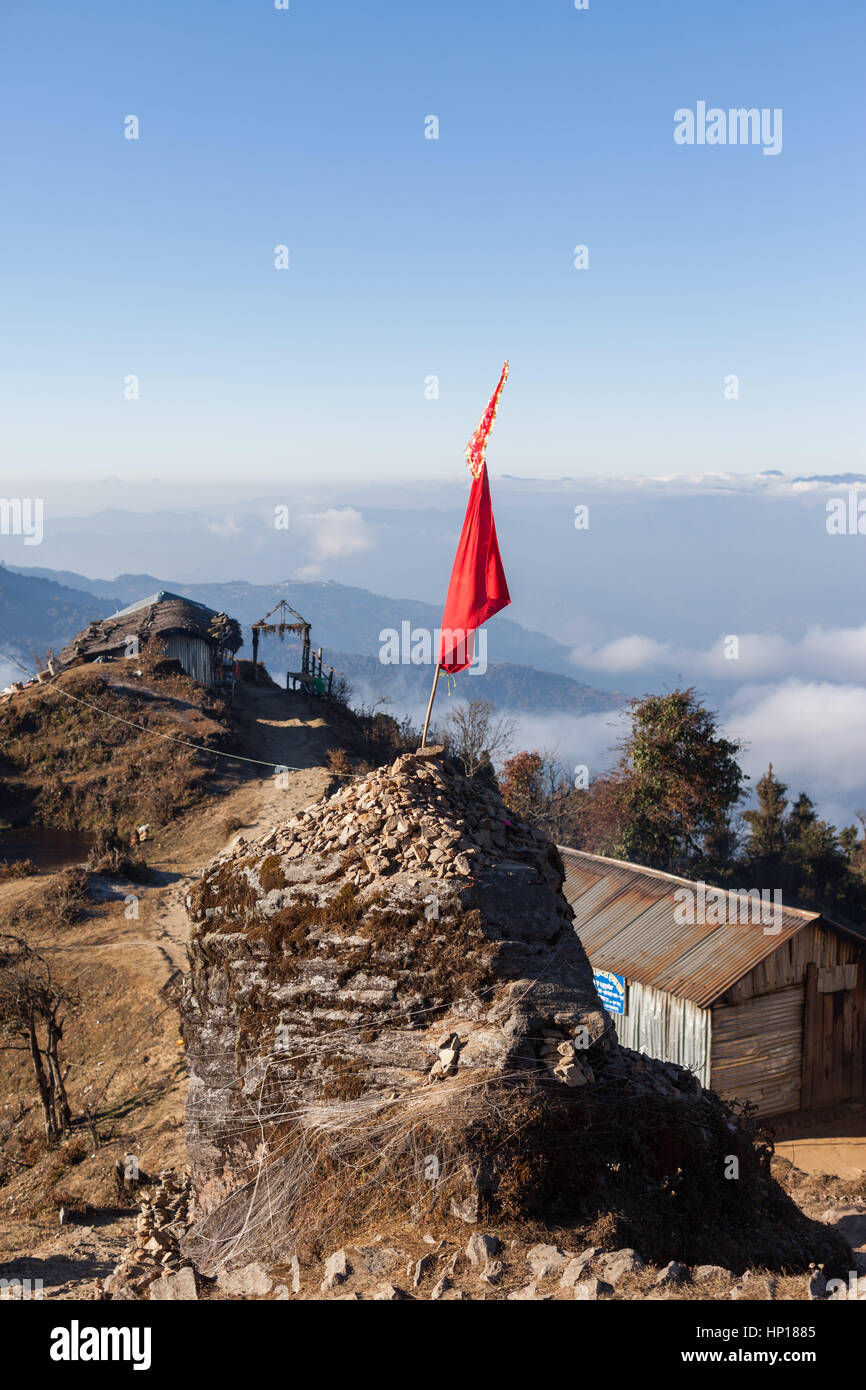 Hindu holy site on the path to Pathibhara Devi Temple with view over the Himalayan foothills, Taplejung, Nepal Stock Photo