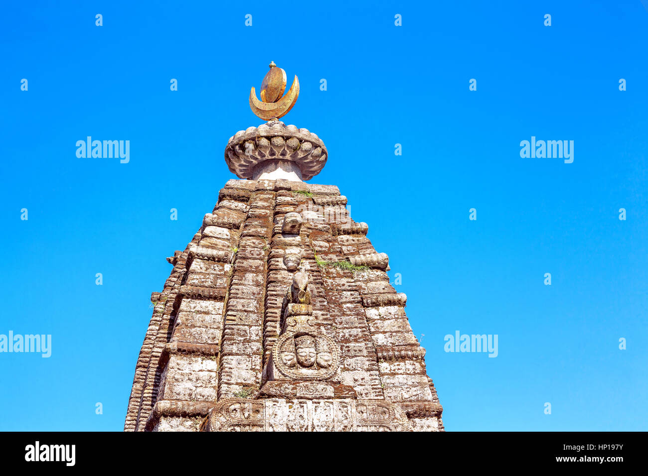 Dome of a traditional Hindu temple on a background of blue sky Stock