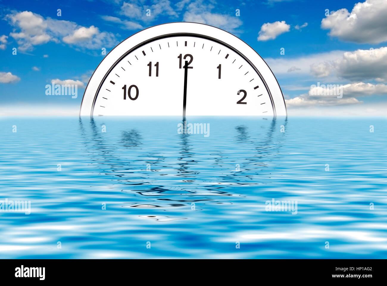 clock at twelve o'clock rising on the horizon of the ocean - Stock Image