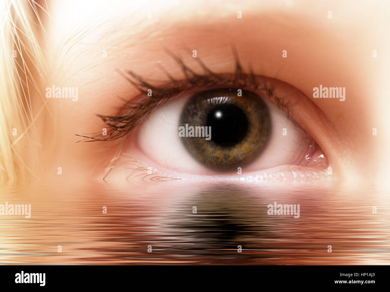 girl eye with reflection in water - Stock Image