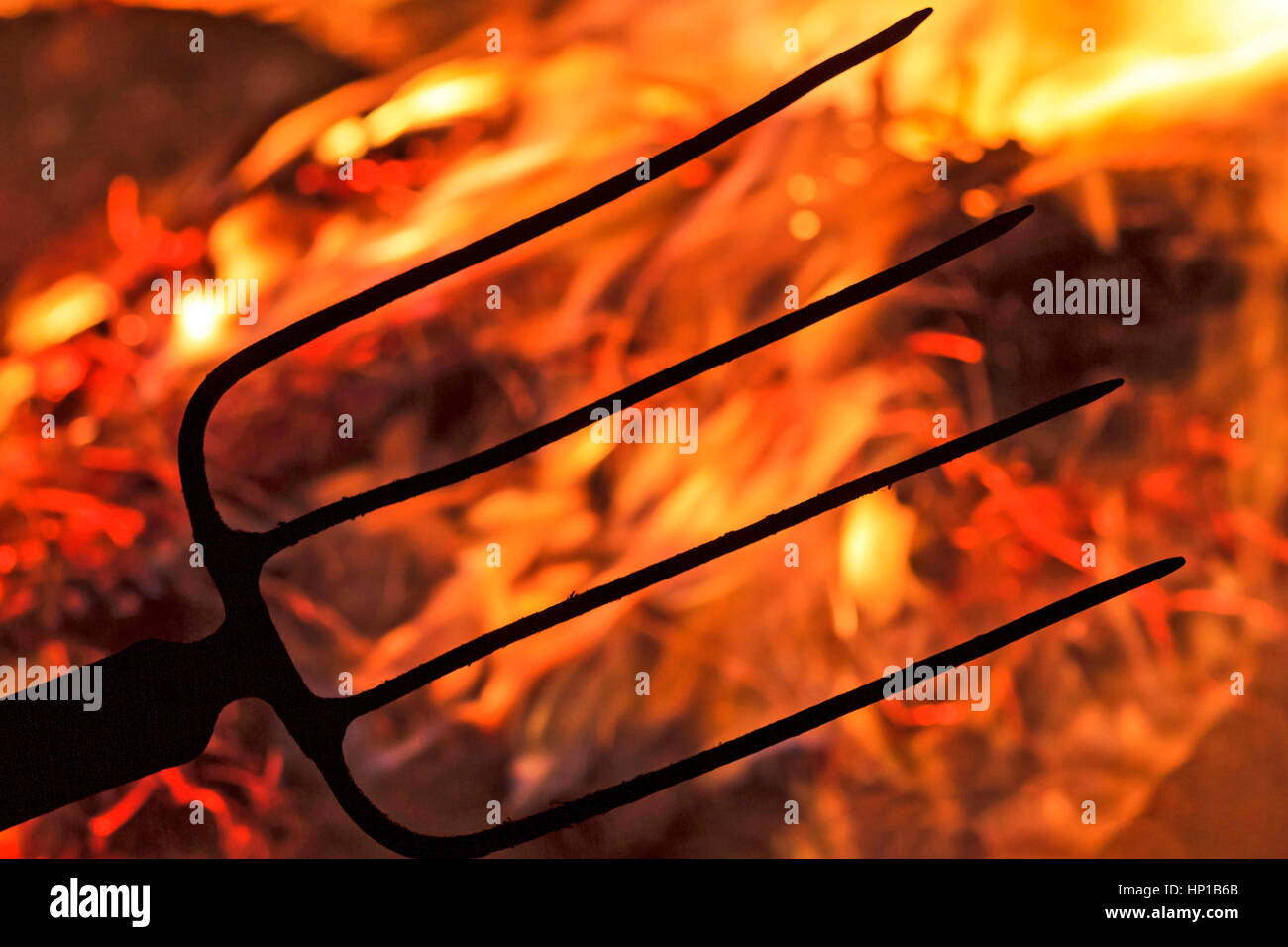 flames of revolution and fork,Revolution, aggression, defense, disagreement politics dictatorship reset - Stock Image