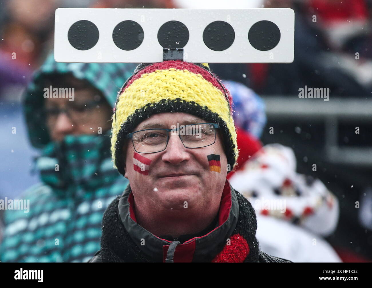 Hochfilzen, Austria. 17th Feb, 2017. A fan attends the women's 4x6km relay event at the 2017 IBU Biathlon World - Stock Image
