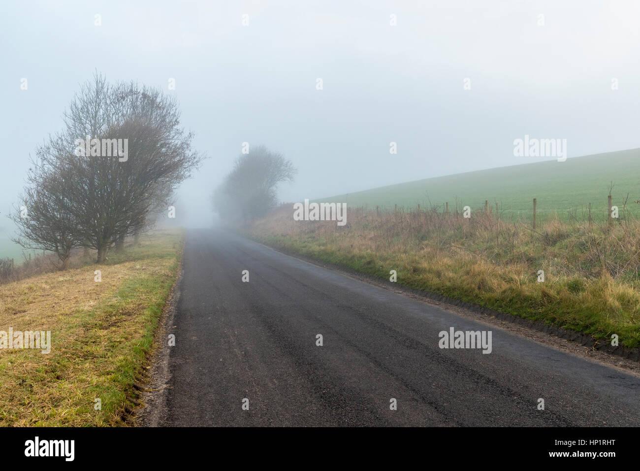 West Lulworth, Dorset, England. 18 February 2017. Mist morning in Dorset Credit: Sebastian Wasek/Alamy Live News - Stock Image