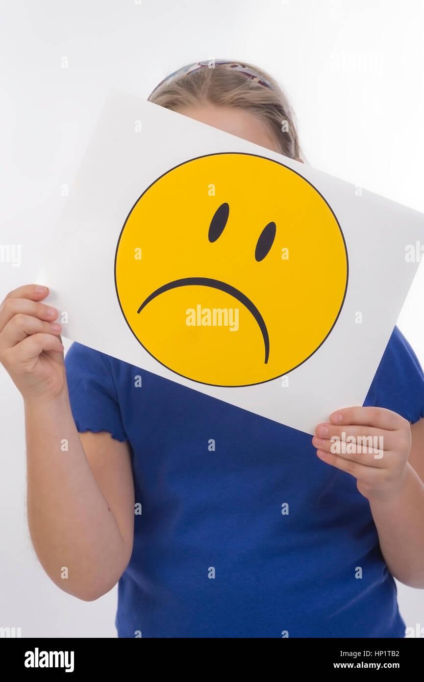 Model release , Maedchen, 8 Jahre, mit traurigem Smileygesicht - girl with sad smiley face Stock Photo