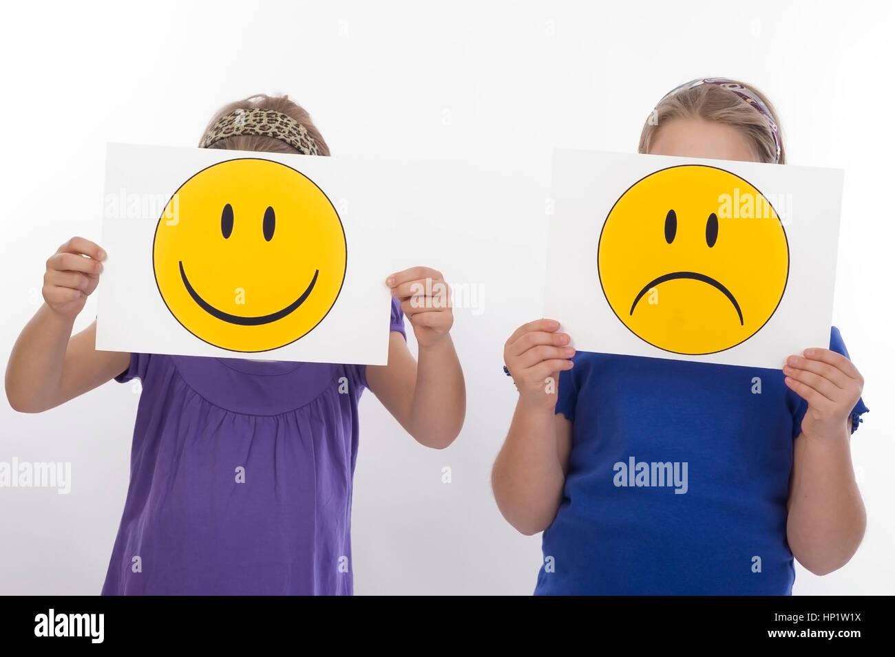 Model release , Trauriges und froehliches Kind, Symbolbild - sad an happy children, symbolic Stock Photo