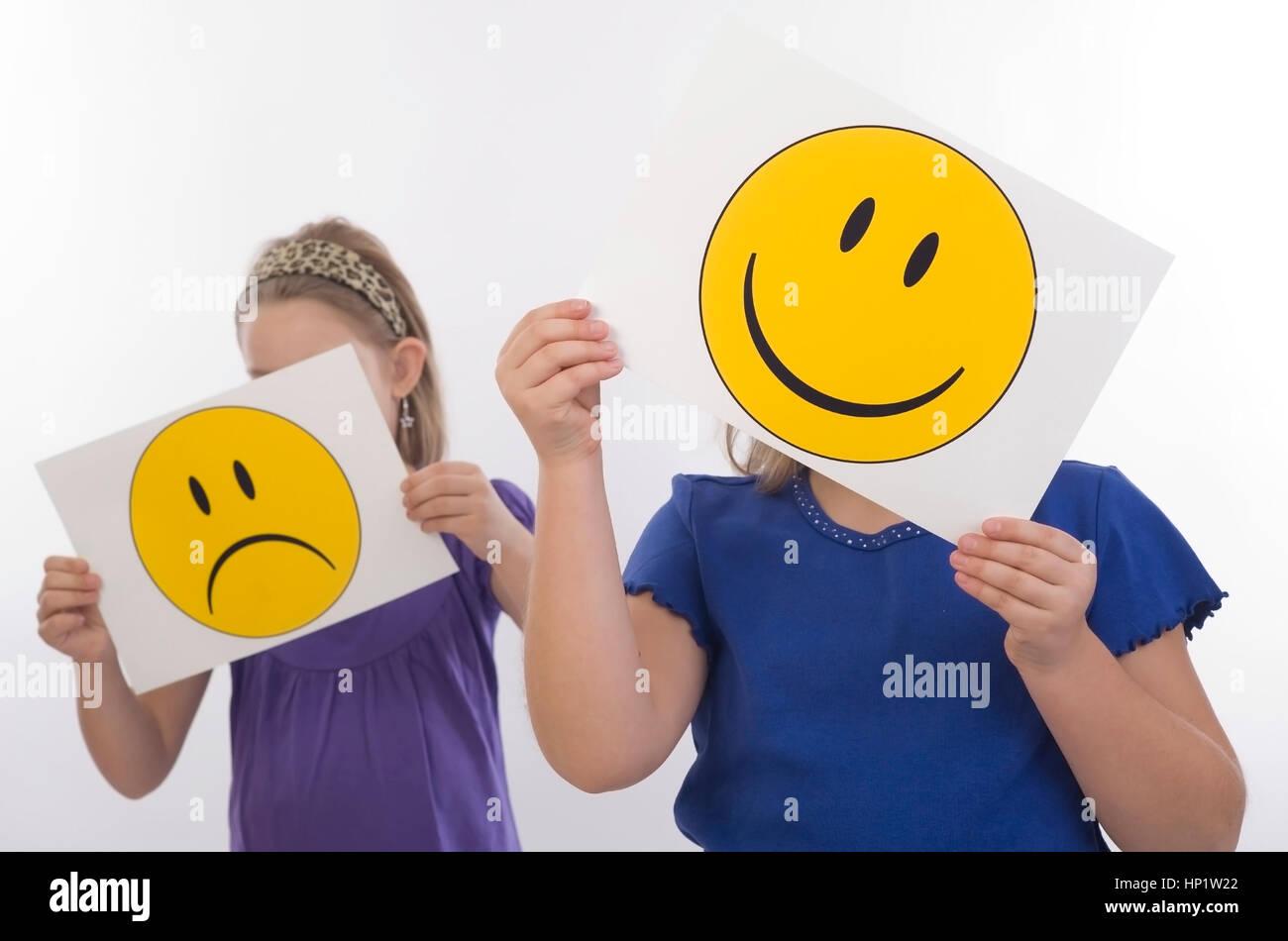 Model release , Trauriges und froehliches Kind, Symbolbild - sad an happy children, symbolic - Stock Image