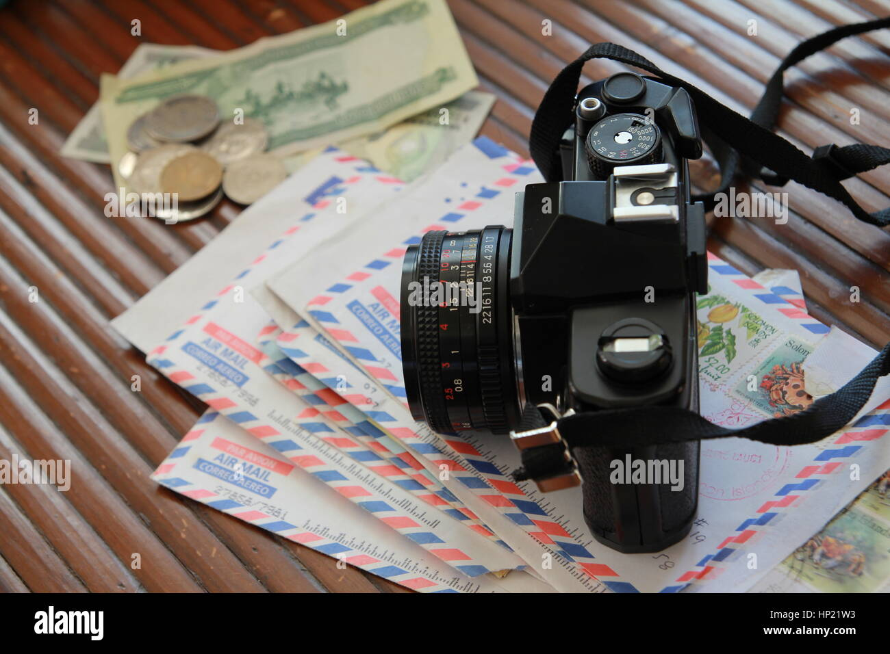 Film camera on stack of air mail letters - Stock Image