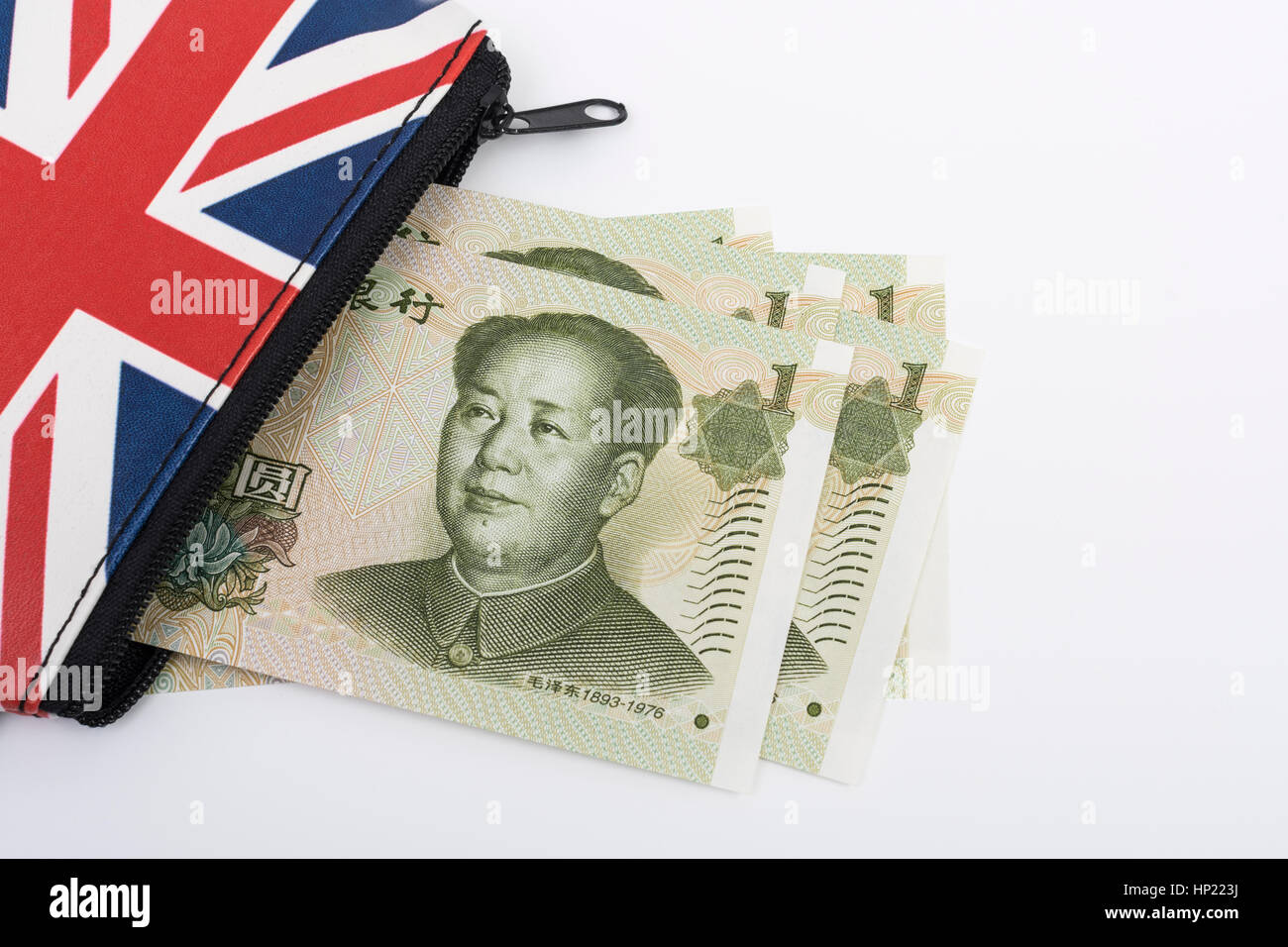Union Jack coin purse with Chinese 1 Yuan banknotes - as metaphor for Yuan / Renminbi-Sterling exchange rate. Stock Photo
