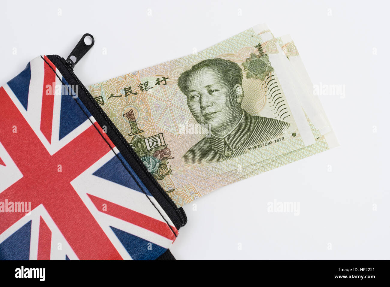 Union Jack coin purse with Chinese 1 Yuan banknotes - as metaphor for Yuan / Renminbi-Sterling exchange rate. - Stock Image