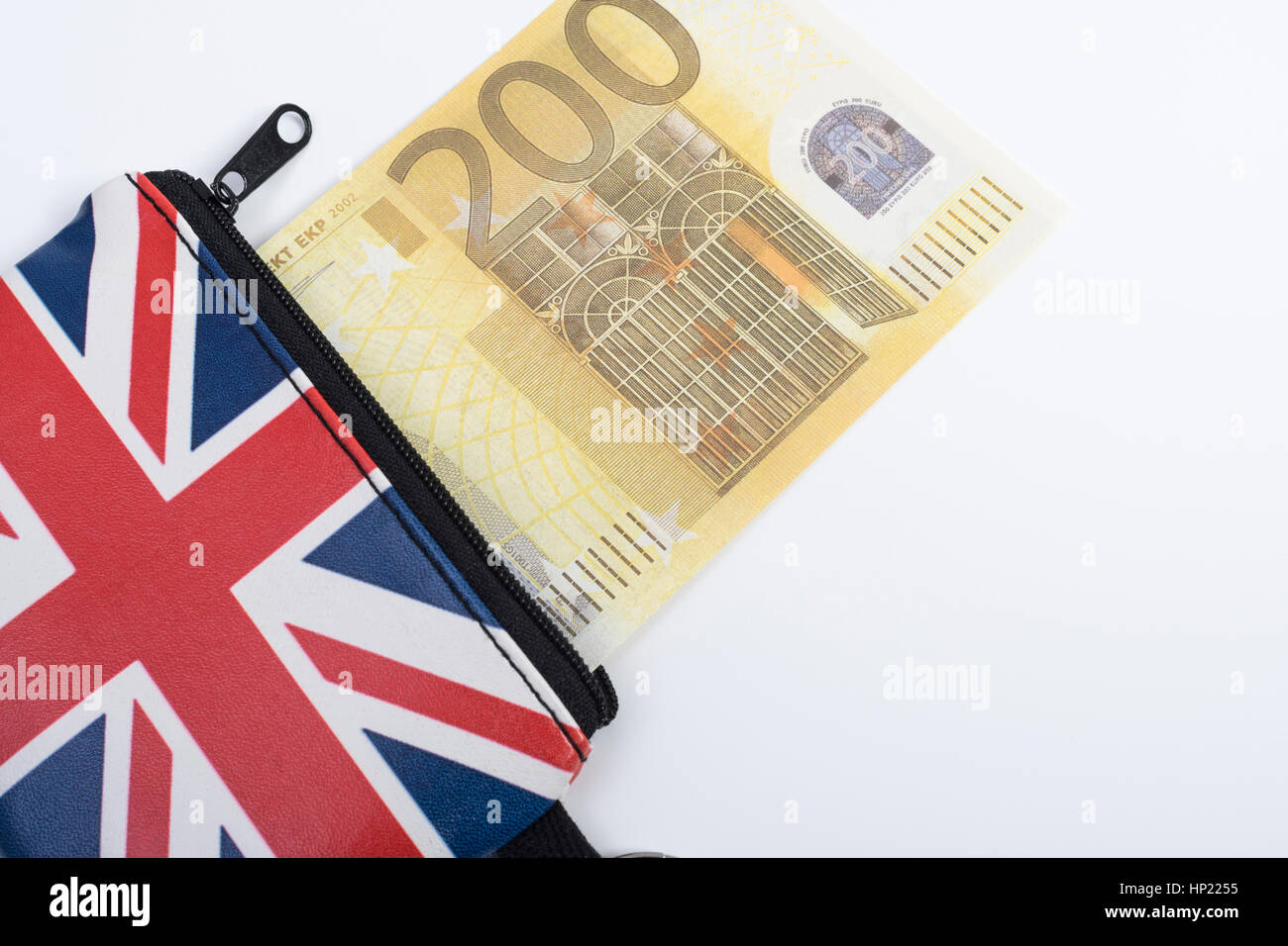 Union Jack coin purse with 200 Euro banknote - as metaphor for Euro-Sterling echange rate. - Stock Image