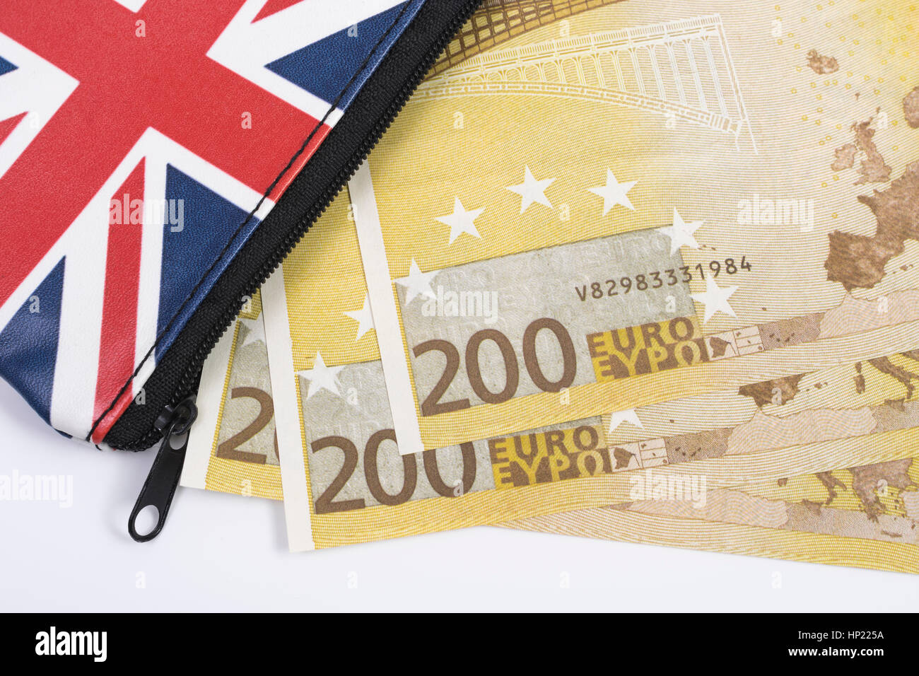 Union Jack coin purse with 200 Euro banknotes - as metaphor for Euro-Sterling echange rate. - Stock Image