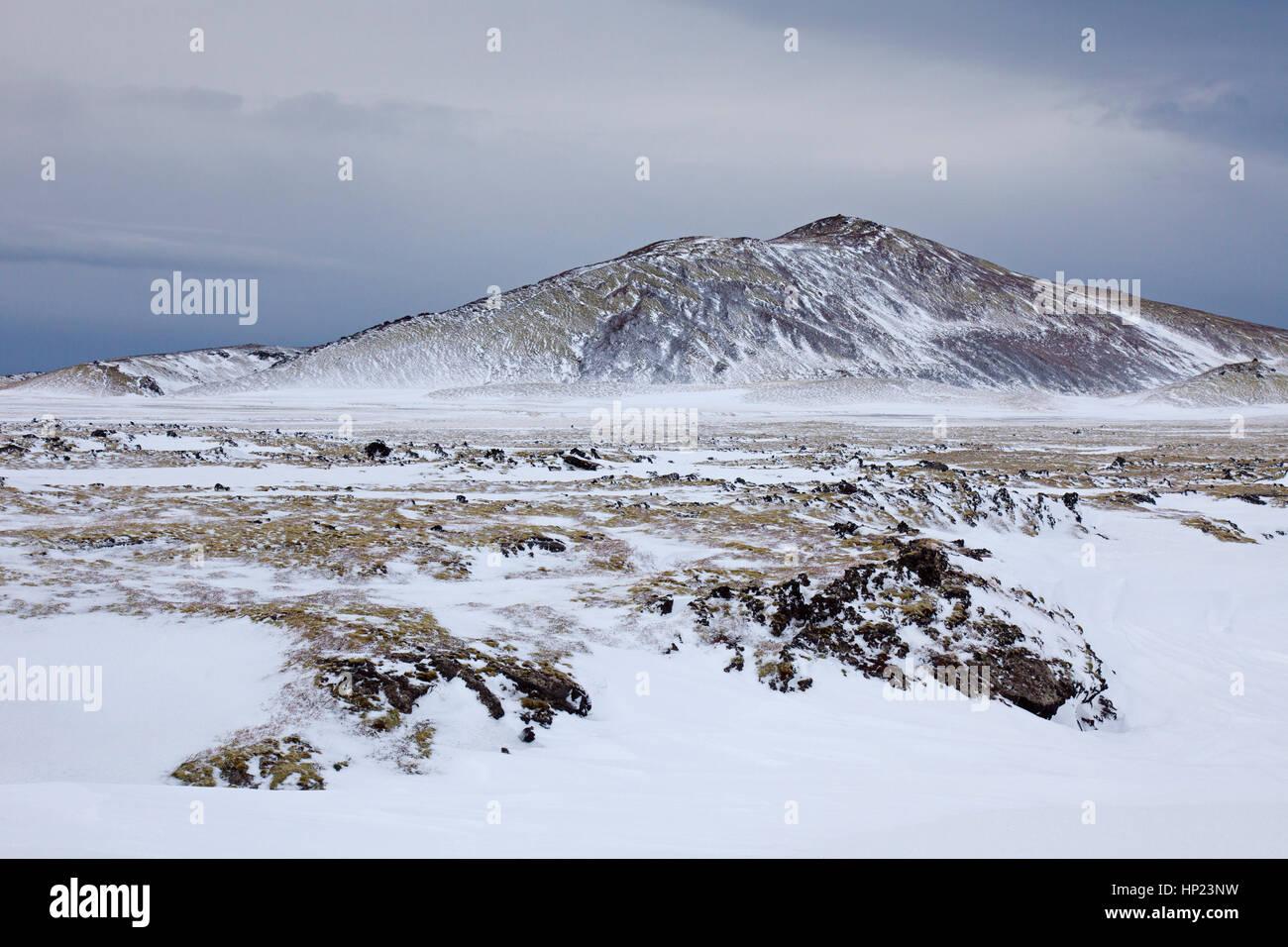Stratovolcano Snaefellsjoekull and lava field covered in snow at the Snæfellsjökull National Park in winter - Stock Image