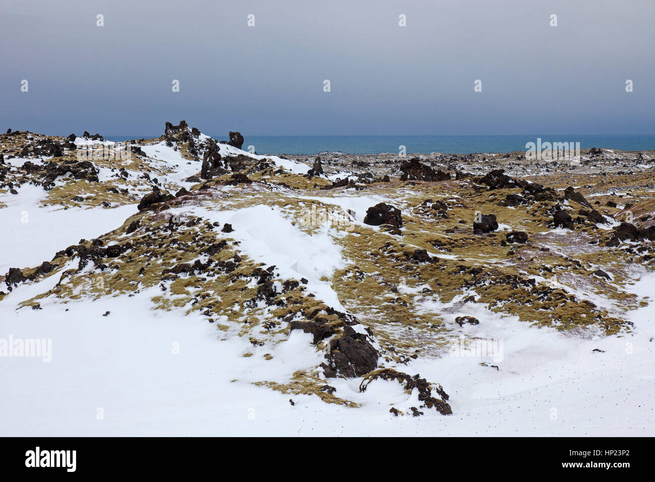 Lava field covered in snow at the Snæfellsjökull National Park in winter on the Snæfellsnes peninsula - Stock Image