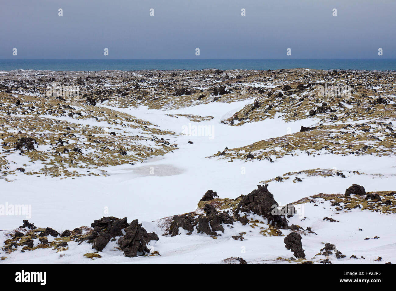Lava field covered in snow at the Snaefellsjoekull National Park in winter on the Snæfellsnes peninsula in - Stock Image
