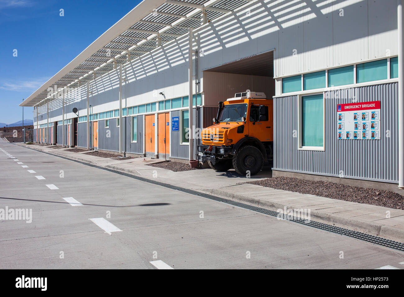 Emergency brigade, ALMA observatory, technical building in Operations Support Facility (OSF),  Atacama desert. Region - Stock Image