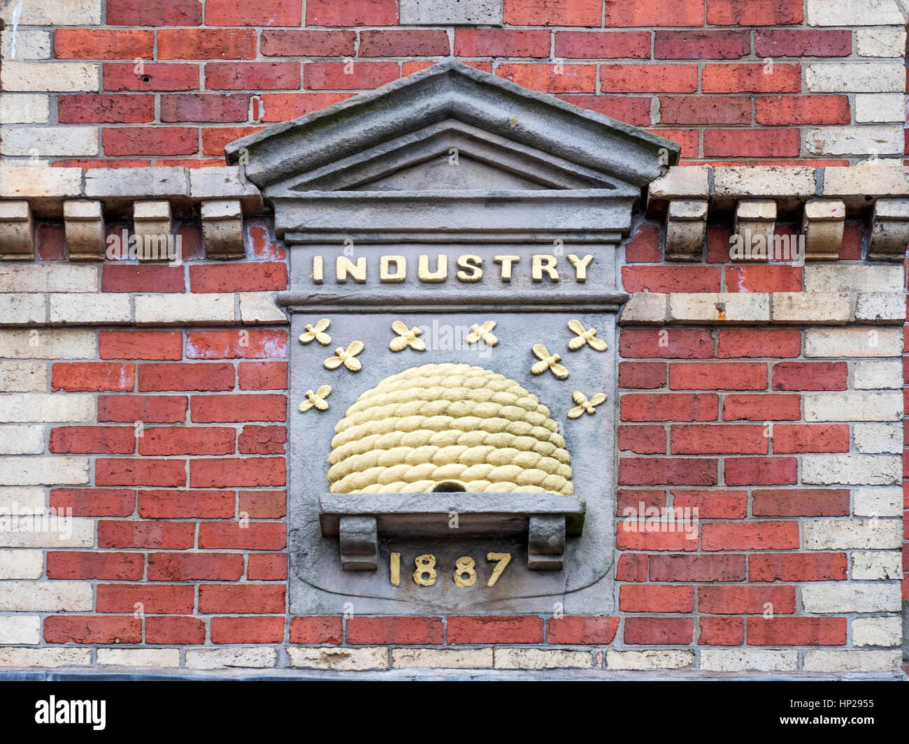 Wicker Beehive with Bees Frieze Dates 1887 at the Library Former Cooperative Building in Durie Street Leven Fife - Stock Image