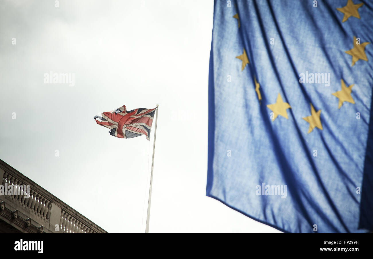 flags of UK and EU combined over icons of London - Brexit concept Stock Photo