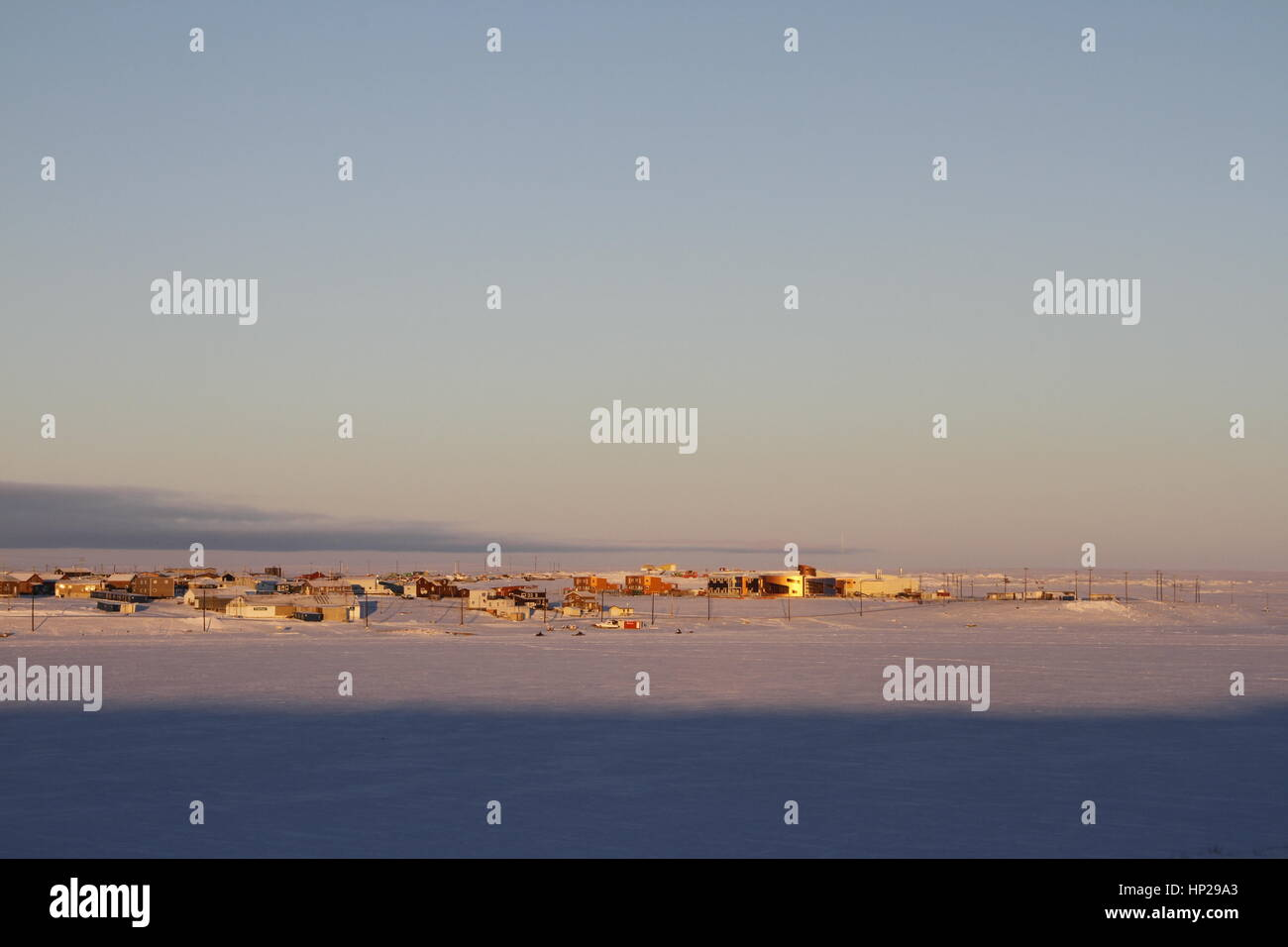 Early morning winter sunrise over Cambridge Bay, Nunavut with the new Canadian High Arctic Research Station on the - Stock Image