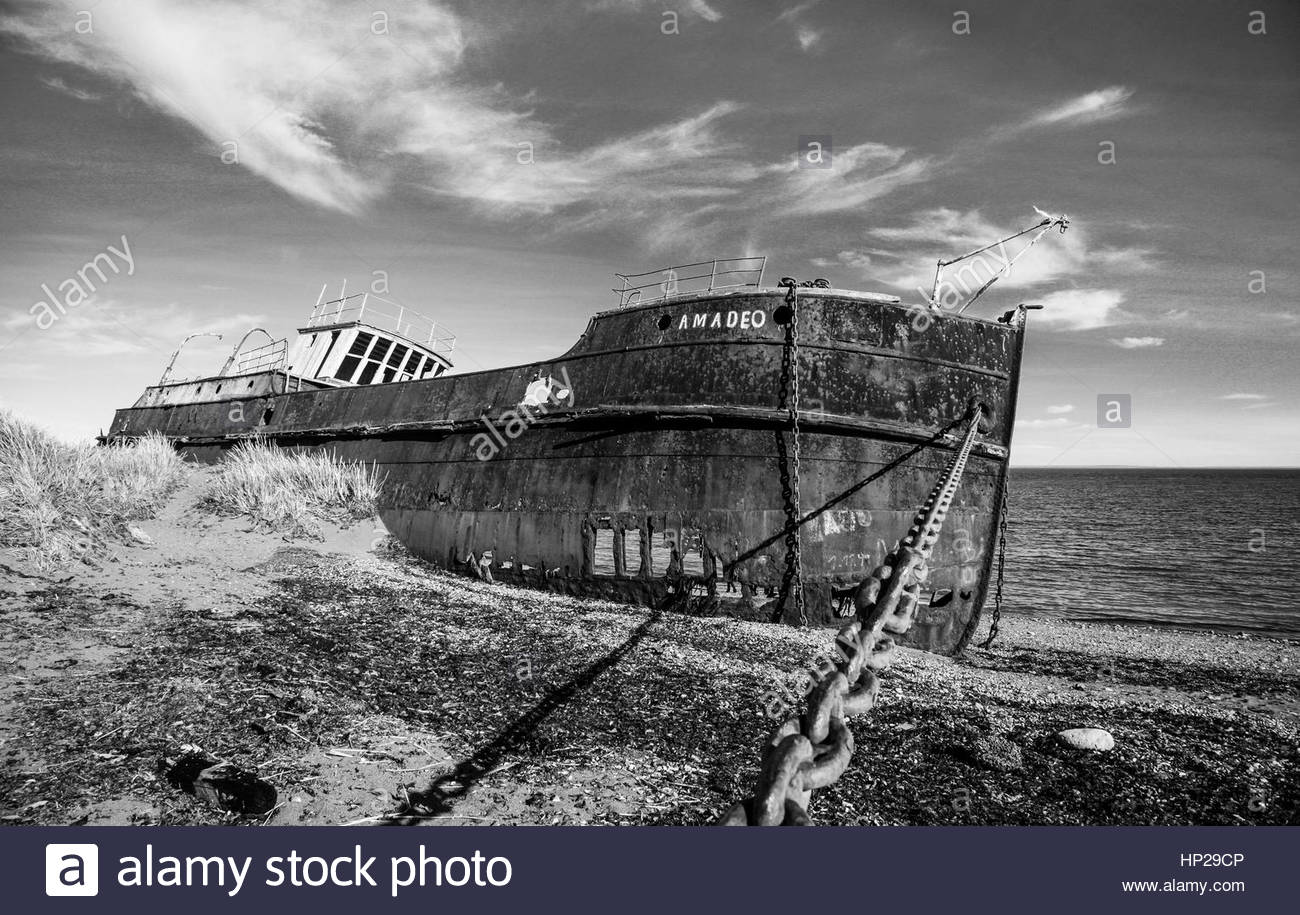 Old ship aground on the Strait of Magellan, Chile - Stock Image
